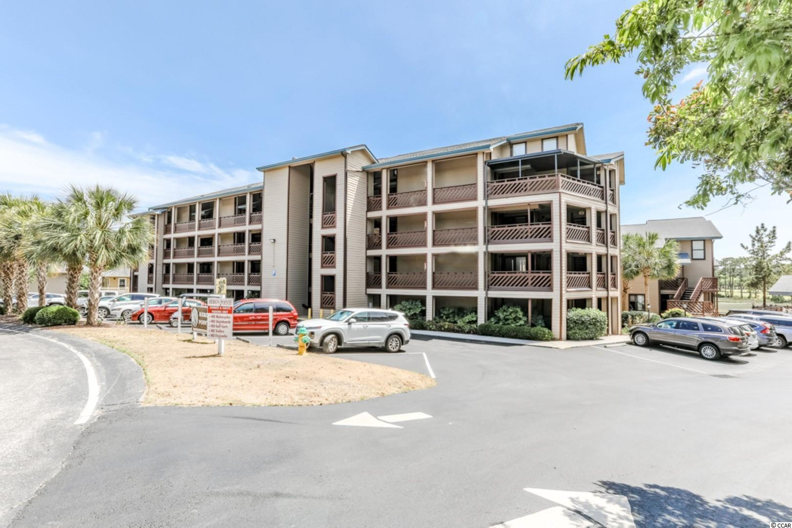 This beautifully decorated and appointed Heron Pointe 2 BR and 2 BA villa is being sold fully furnished.  One of its greatest features of unit F-1 is that it is located on the second floor and it is in the only Heron Pointe building with an elevator.  Unlike most condominiums at the beach, this spacious Heron Pointe floor plan provides over 1200 heated square feet of space, more than enough square footage where you and your guests will actually enjoy some privacy during your vacation stay.  Heron Pointe F-1 also features large screened in porches.  One is located at the front entrance and the other is accessed from both the living room and the master bedroom and faces the inlet and marsh.  The beautifully landscaped Heron Pointe community features an outdoor swimming pool and a heated indoor swimming pool for anyone's enjoyment when they do not wish to go down to the ocean.  The heated indoor pool is a particularly favorite amenity to our northern guests who prefer living at Heron Pointe during the winter months.  This amenity alone has made Heron Pointe a preferred off season destination.  Heron Pointe is located in the very popular Arcadian Section of Myrtle Beach.  The Arcadian Section has remained a favorite resort location because of its pristine beaches and central location to area amenities.  From Heron Pointe your are a very short drive to all kinds of restaurants, challenging golf, shopping at malls and outlet centers, and incredible family entertainment like the Carolina Opry and the Alabama Theatre. Please call and make an appointment to view this incredible property. Square footage is approximate and not guaranteed. Buyers responsible for verification.