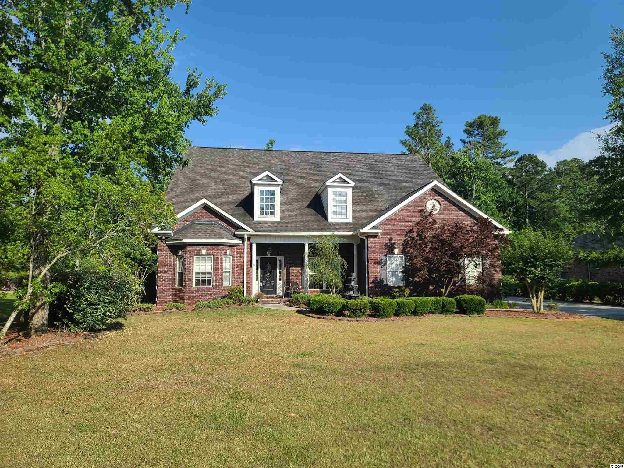 Spacious all-brick 4 BR/3.5BA with a 2 car garage on a HUGE .61 acre lot!  You'll be impressed by the extensive trim package and open concept floor plan, with a Formal Dining Room and a large Office that could be used as the 4th bedroom.  Just beyond the stunning Family Room is a Carolina Room, separate by a gorgeous double-sided fireplace.  Adjacent is a bright Kitchen and Eating area that boasts tons of cabinet space, including a work island and gorgeous granite counter tops that highlight the Stainless Steel Appliances.  The Master Suite is conveniently located on the First Floor, and features a luxury Master Bath with double sinks, custom tile shower, and a garden tub.  Separate In-Law or Guest Suite offers it's own full bath and is perfect for someone needing a private room on the first floor.  Just minutes to many fine restaurants, shopping and the beach!  Don't miss this one!
