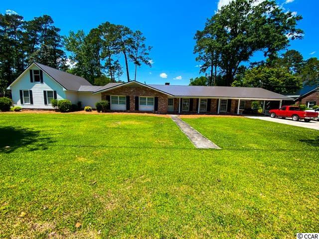 Very large sprawling ranch style home on .71 acre lot inside the city limits of Conway. 5 bedrooms 3 baths. Slate floor in foyer.  Hardwood in the formal living room and has some hardwood under some of the carpet. Master is very large with a spacious bath. Upstairs is a bonus room which could be the 5th bedroom. Double carport with extra parking pad. Detached garage/workshop that is heated and cooled, perfect for the man cave.  Also has a detached 1.5 story building for many different uses.  Huge deck on the rear. Laundry room is spacious and has an outside entry.  HVAC is only a few years old and a new roof in 2021.