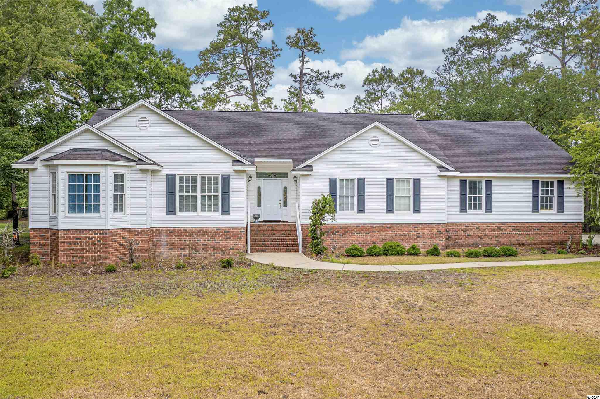 WATERFRONT with deck and deep water dock on Waccamaw river...approx. 5 acre pond in front of house...less than 15 minutes to Myrtle Beach, downtown Conway...ideal quiet neighborhood setting with a little country flare...located just off of Old Reaves Ferry Rd. and Hwy. 90 with easy access to Hwy. 22...bring your fishing pole and enjoy a little R&R on your river front property. This property is a handy mans dream, it just needs the finishing touches to make this home your own.