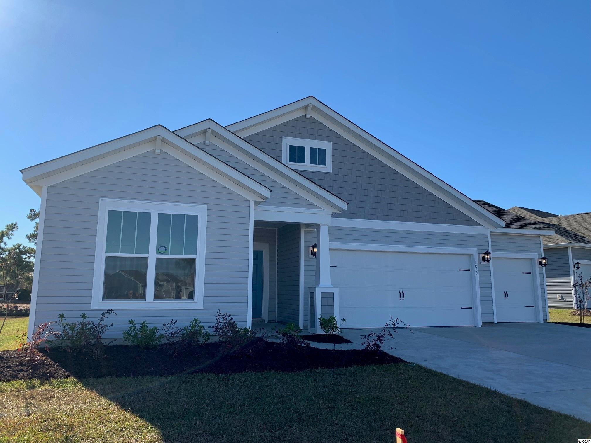 """This personalized Georgetown (COL Coastal front Elevation) home features a 3-car garage, 3 bedrooms, 2 baths, and an open concept design with the kitchen open to the dining room, great room, and Carolina room.  A lovely canal view can be enjoyed from the kitchen, dining room, great room, Carolina room, and primary bedroom.  The marvelous primary bedroom creates a charming escape with a bay window and generous primary bath that offers a huge walk-in tile spa shower with a glass enclosure, rain showerhead, wall showerhead, tile dry-off bench, a double sink vanity and a water closet.  This Georgetown boasts upgraded features: Whirlpool stainless steel kitchen appliances, Daltile tile in all baths and the generous laundry room, easy care Mohawk Rev Wood laminate flooring in the living areas and bedrooms.  Crisp white Level-2 42"""" Master Brand cabinets, Level-2 Simply White quartz countertops, and a Level-3 Smoked Pearl Daltile backsplash create a cool coastal motif in this entertainer's kitchen.  All chrome Moen plumbing fixtures and Progress Light fixtures throughout.  Attic storage with pull down stairs is offered above the 2-car garage.  A natural gas grill line was added off the Carolina room.  The spacious laundry room includes a natural gas dryer connection.  A natural gas tankless Rinnai water heater and Energy Start Certification creates more comfort at a lower cost.  The Belle Mer community offers amenities galore; a community pool, clubhouse, exercise room, sidewalks, fishing and non-motorized boating lakes, and a premier location less than 3 miles to the beach, across from South Strand Commons shopping and dining venue, and so much more!"""