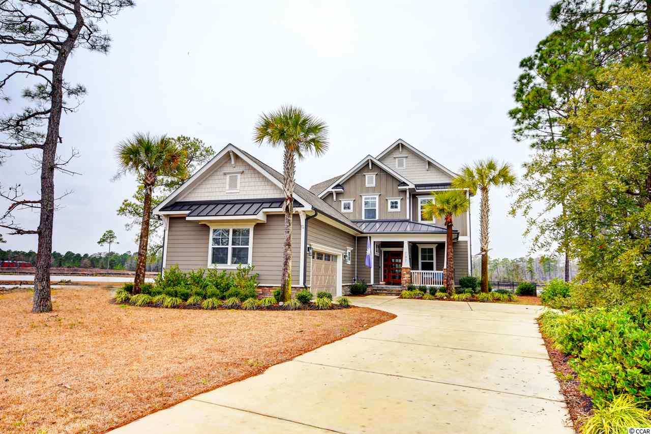 Come see this gorgeous custom built home with breathtaking lake views  in the prestigious gated Waterbridge community. From the moment you step into this home you will not want to leave. The home features 4 bedroom , 3 1/2 baths, flex room on the first floor,  a recreation room on the second with exquisite detailing throughout. This is a Smart Home that was equipped  with the devices that can be automatically controlled remotely from anywhere with an internet connection. First floor has an open floor plan with one of the master suites , an over-sized walk-in closet, master bath with double sinks, walk-in shower and a whirlpool tub. The large kitchen has stainless steel appliances , gas stove, pantry, a huge island and a breakfast nook. Family room has a fireplace, surround system and a covered screened lanai where you can relax with a cocktail watching the sunsets over the lake. Second floor has a second master bedroom and a rec room with a covered porch over looking the lake, and two guest bedrooms. Home sits on a lot with a private iron fence. Beautiful landscaping and exterior lighting system make this house standout at night.  Seller also owns a lot next door and willing to sell with the right offer.  Waterbridge is surrounded by 120 acres of protected woodlands and has over 60 acres of scenic lake views. The development is enhanced by fitness center, tennis court, basketball, firepit, community boat launch and a sand volleyball. You must see the resort style pool with swim up refreshment bar and a clubhouse.  Dont miss such a great opportunity to call this home yours!