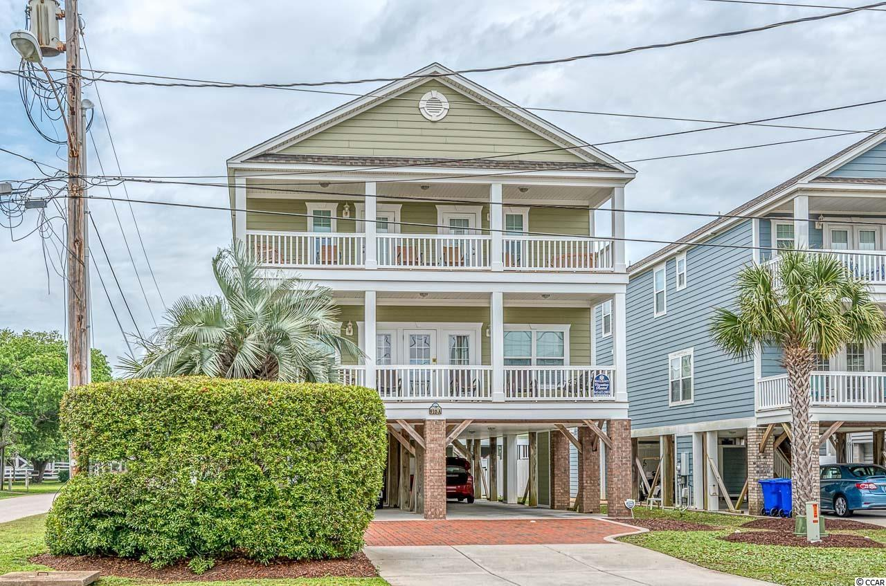 """""""Coastal Dreamin"""" is a 7br, 7.5ba home on a large second row corner lot at 9th Ave North in Surfside Beach with beach access directly across the street. Just 1/2 mile North of Surfside Pier.  Full home length front deck/balconies on both levels. Large heated pool, outdoor shower & picnic area on ground level, Sold Furnished. Great second home and/or rental property."""