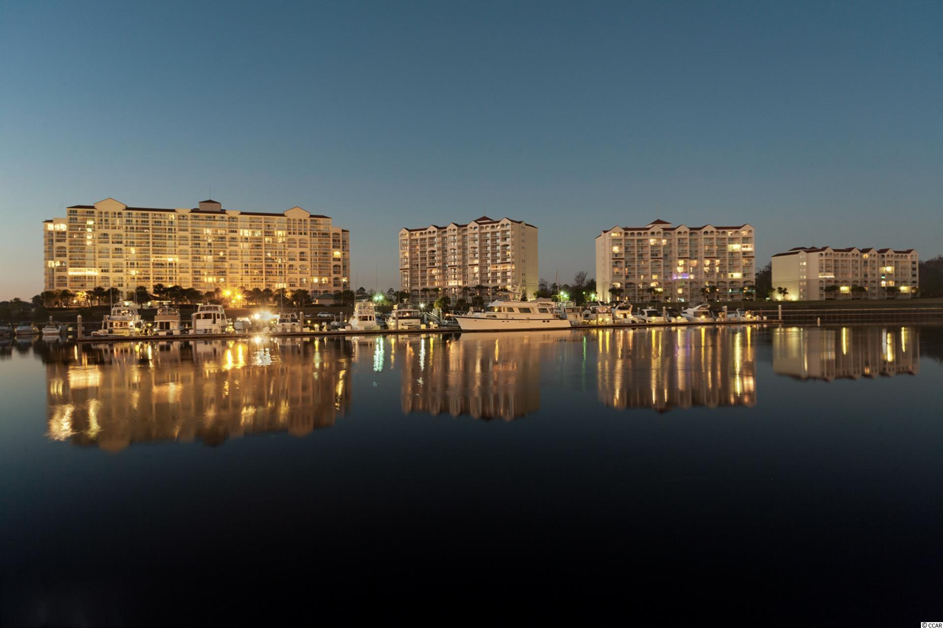 Here is a wonderful opportunity to own a furnished 4 bedroom unit on the Waterway that has spectacular views.   This unit is a lockout so that it not only can be a great investment property, but could also be a second home.   There are many upgrades, including new vinyl flooring, stainless appliances, new washer/dryer, newly painted, the entrance and around the breakfast bar is beadboard.  The 3 lockout units off of the main unit all have their own entrances so you could live in the main unit and rent out the lockout units for an income producing property.  There are 3 balconies for spectacular views of the Intracoastal, the Barefoot Marina and Barefoot Landing.   The kitchen overlooks the dining area and living room and has a view right out to the waterway, with a rounded breakfast bar that is great for entertaining. The refrigerator, dishwasher and microwave are all stainless. Barefoot Resort is a wonderful development with close proximity to the AtlanticOcean, and Barefoot Landing for shops, restaurants and other activities. Come and enjoy the Barefoot Lifestyle, you'll be glad you did.