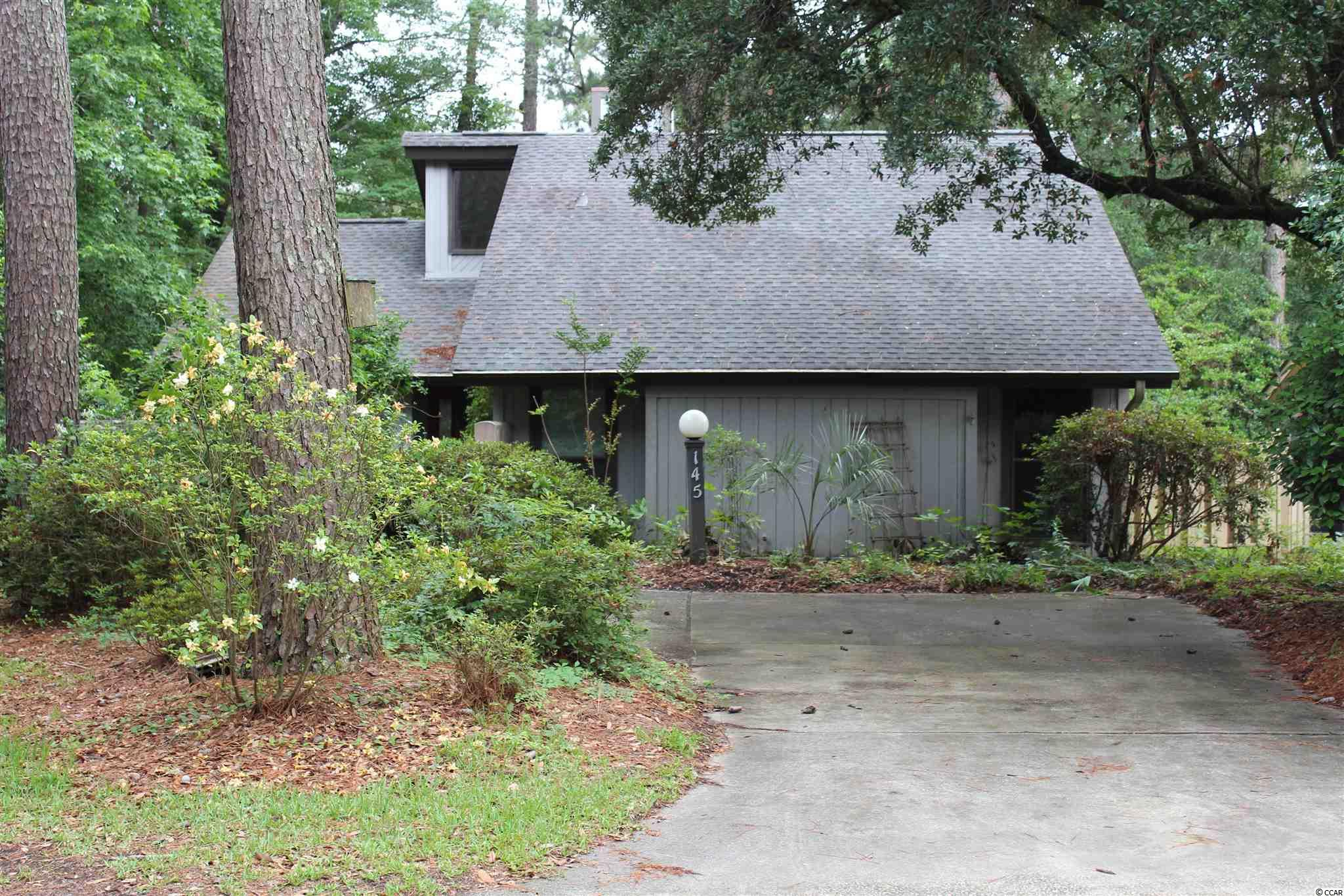 Patio home on the golf course, vaulted ceiling in great room and fireplace. Home has a large Carolina room, three bedrooms, two baths, dining room and eat in kitchen. Very private. Tile floors in most of the home. Quail Creek Village is across the street from CCU. Home is located on Quail Creek Golf Course.