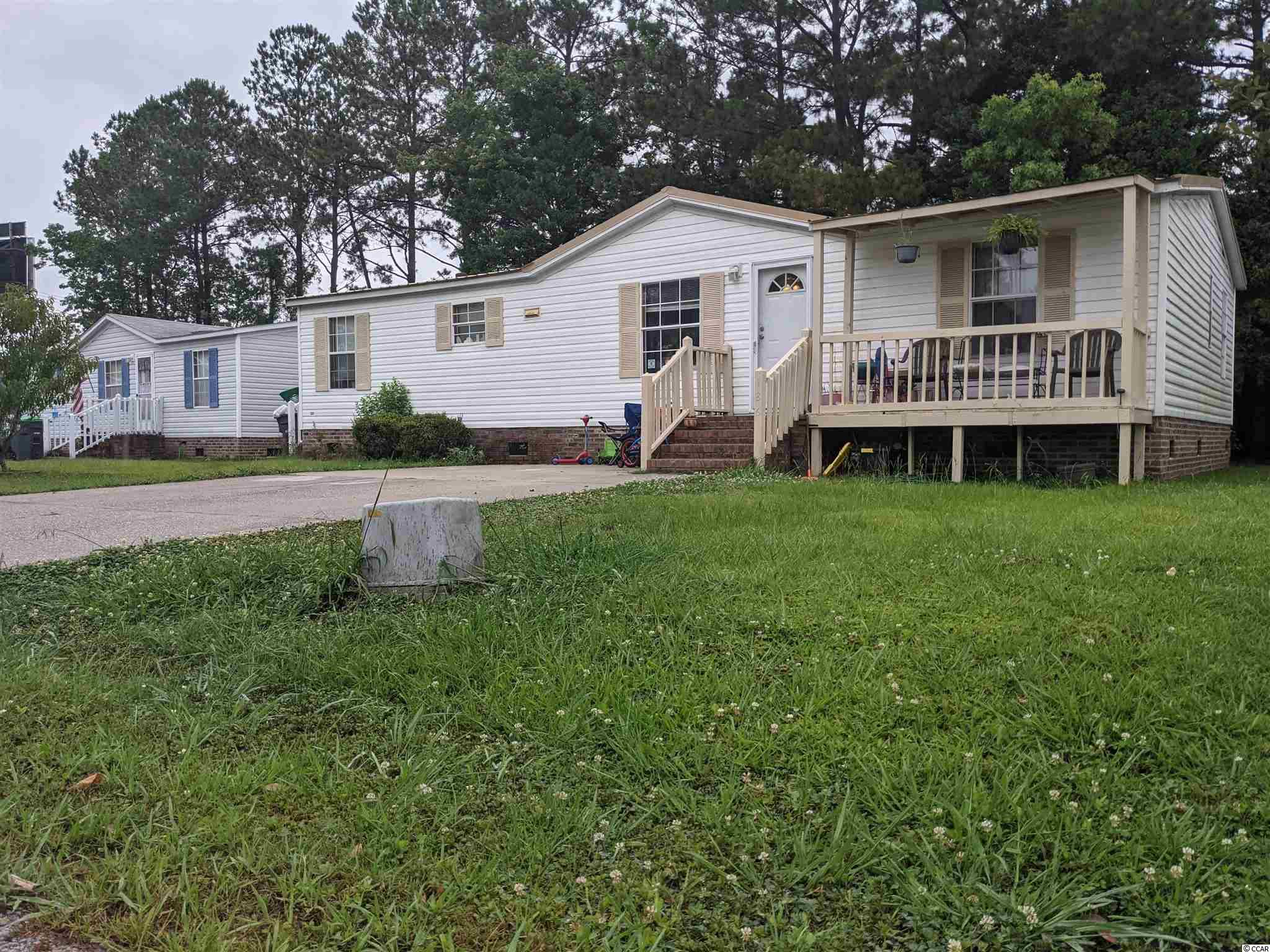 This 3 bedroom 2 bath home is located in a 55+ community. The owner has made improvements during her ownership. These improvements include Metal Roof, New Flooring, HVAC replacement, Stove upgrade, Sliding Glass Door and Front Door. This home has a split bedroom plan, storage building, oversized back deck and a new extended front porch. This home is being sold as is, seller is not aware of anything wrong other than some cosmetic items.