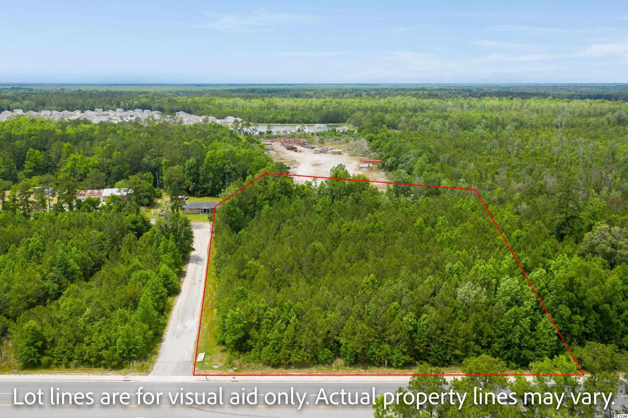 Build your dream home on 1.87 acres, with no HOA located on Hwy. 707 in Myrtle Beach. Land can also be subdivided into 20,000 sq. foot lots, equaling 3 separate home-sites. No timeframe to build. Land is approved for stick builds or manufactured homes. Location provides easy access to restaurants, shopping, golfing, and the beach.