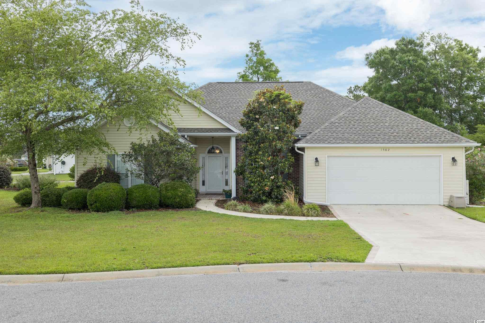 Welcome home to this well maintained home in the neighborhood of Southwood in Surfside Beach, South Carolina. This home has all 3 bedrooms and 2.5 bathrooms on ONE LEVEL and is a corner lot! Situated on a corner lot in a cul-de-sac off of Heathmuir Drive there is curb appeal and mature landscaping in the front! There is an extended painted driveway that leads to the 2 car garage and walkway to the front door. Walkthrough the front door and have your formal dining area on the right and an open living room with vaulted ceilings. The living room opens to a beautiful Carolina Room with tile floors, a vaulted ceiling, ceiling fan, easy breeze windows and a door that leads to the outside patio space. Two bedrooms with ceiling fans are up front to the left and they share a bathroom. The owners' suite is on the first floor and also has a tray ceiling, a ceiling fan, the option or a shower or bath, and a walk-in closet. The kitchen features plenty of upgraded cabinets, counter space, a pantry, ceramic tile floor, breakfast bar, and a dining nook. The kitchen overlooks a popular living area for entertaining that has a fireplace, vaulted ceilings, a ceiling fan, custom built-ins and has a convenient half bath. The laundry room has separation between the garage and kitchen and features extra cabinets. There is a sink in the garage, detachable hurricane shutters, gutters, a NEW ROOF in March 2021, irrigation and is getting a brand new stainless steel electric range and microwave. Located in Southwood in Surfside, this home is conveniently located to an option of beaches, airport, easy access to Highway 17Business or Bypass, Hwy 544, restaurants, stores, and golf courses. Southwood has a low HOA and has two neighborhood pools.Schedule your showing today!