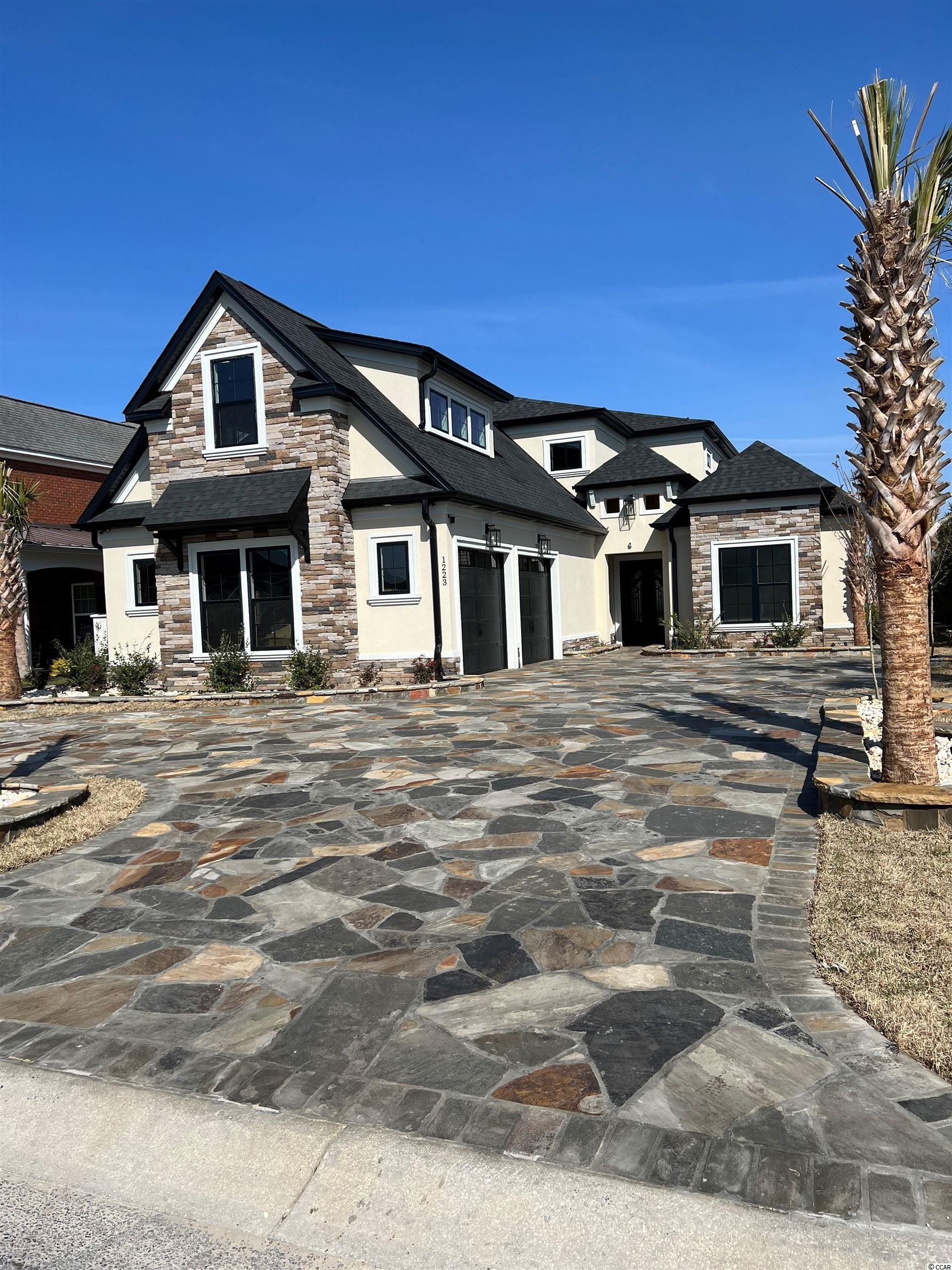 """This beautiful new construction home will be completed in early 2022! Located in the highly sought after Carolina Waterway Plantation that is a gated intra coastal waterway community with private boat storage and boat launch access. If you are looking for a 100% custom home with quality upgrades and finishes this is it. This home will be loaded with all of the upgrades would expect in this price range including LVP flooring throughout upgraded countertops, soft close all wood cabinets, all showers are tile including a large shower and tub in the master bathroom, custom wood shelving in your oversized master walk in closet, large tray ceilings, appliances credit will be given, crown molding and upgraded lighting package. Carolina Waterway is located conveniently near Hwy 501 and Hwy 31 for quick easy access to all of Myrtle Beach and surrounding areas have to offer. Buyers if purchase in time will be given choices for certain finishes. Book your showing today as you will not be disappointed! Beautiful large lot with pond/fountain views! Lot is large enough for a POOL and will come with an outdoor BBQ area.  """"MAIN PICTURE IS A VERY SIMILAR HOME UNDER CONSTRUCTION IN THE COMMUNITY BY THE BUILDER"""""""