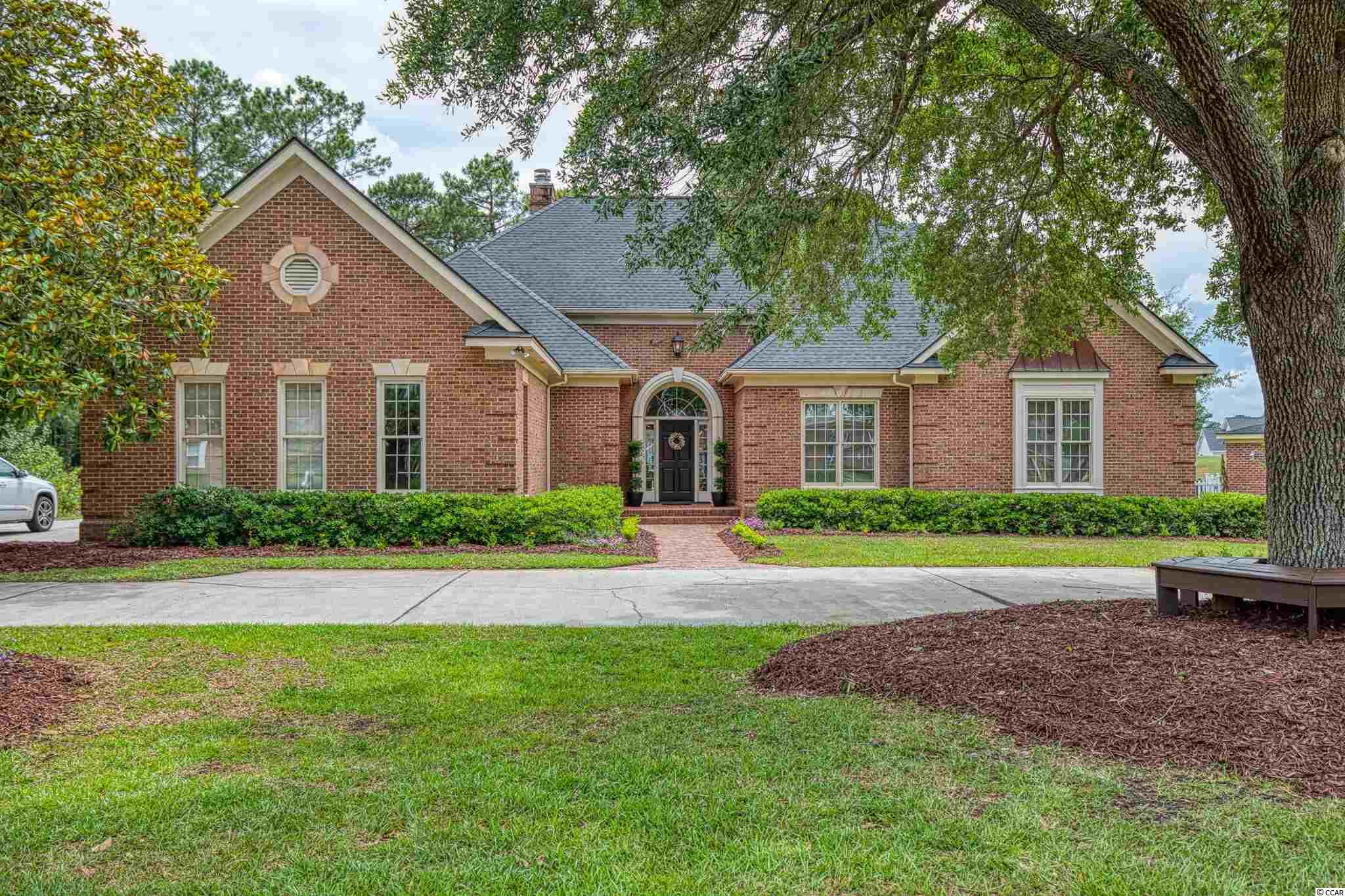 This custom built brick home is situated on a 0.44 acre lot overlooking the second green of Burning Ridge Golf Course.  Forest Lake Estates is a highly desirable community with a private gated entrance as well as the main entrance off of Highway 501.  You're welcomed to the home with a beautiful mature live oak in the front yard, an oversized side loading garage and a brick walkway to the front door.  Upon entering the home you will find an open airy living room with a gas fire place and French doors leading to the Carolina room.  Through another set of French doors is the spacious, open concept living room with hard wood floors, a second gas fireplace, work station, and a bay window perfect for a breakfast nook.  The kitchen is well laid out with granite countertops, a breakfast bar, and plenty of storage space.  The master bedroom has tray ceilings, access to the brick patio, a walk in closet and a jacuzzi tub in the master bath.  The two additional bedrooms are Jack and Jill style with the second full bathroom shared between them.  There are two half bathrooms; one is a powder room and the other is in the laundry room.  Two large attics offer plenty of supplementary storage room.  The outdoor space in the back of the house features a brick patio with a golf course view with plenty of room for entertaining.
