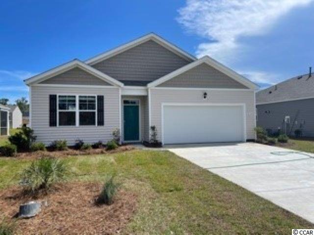 Oyster Bluff is now selling! Brand new natural gas community just minutes away from shopping, dining, and the beach. Our Cali plan is the perfect one level home with a beautiful, open concept living area for entertaining and 9' ceilings throughout. The kitchen features granite countertops, an oversized island with breakfast bar, white painted cabinetry, a walk-in pantry, and stainless Whirlpool appliances. The large primary bedroom suite is tucked away at the back of the home, separated from the other bedrooms, with a double vanity, 5 ft. walk-in shower, and linen closet in the en suite bath. Low maintenance laminate flooring in the entire home gives the look of wood with easy care and cleanup and the spacious rear screen porch with water views adds great outdoor living space. Tankless gas water heater and a two-car garage with garage door opener also included. Ask an agent today about our industry leading smart home technology package, our QuickTie framing system, and all of the energy efficient features that are included in each of our new homes. An additional concrete patio was also added off the screen porch along with blinds throughout the home.  *Photos are of a similar Cali home. (Home and community information, including pricing, included features, terms, availability and amenities, are subject to change prior to sale at any time without notice or obligation. Square footages are approximate. Pictures, photographs, colors, features, and sizes are for illustration purposes only and will vary from the homes as built. Equal housing opportunity builder.)