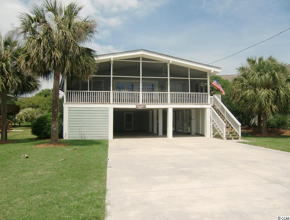 Beach Cottage on Parker Drive in North Litchfield - less than 2 minute walk to the beach! 6 Bedrooms (4 on the main level and 2 on ground level with outside access only) and 3 bathrooms (2 main level, 1 downstairs). This beach home has a large screened porch on the ocean side, and glass doors leading into the living area. The porch is large enough for rockers, a sitting area, plus a picnic table. You can hear the ocean and feel the salt air breeze.  The classic Litchfield Beach house open floor plan has the living, dining areas and kitchen in the middle, and 2 bedrooms on the left side, and 2 bedrooms on the right side. All rooms have vaulted ceilings. Bedrooms have connecting baths, one with a walk-in shower and the other with a tub combo. The ground floor per county records is approximately 350 sq/ft, has 2 bedrooms, a bathroom and separate laundry/ storage room that is accessed from the covered carport.  These ground level bedrooms have window AC units and baseboard heat.  Upstairs has central AC and baseboard heat. Home has been on The Dieter Company Vacation Rental Program for many years. North Litchfield has a voluntary HOA that helps with beach accesses and provides discounts for bulk trash, cable, and internet.