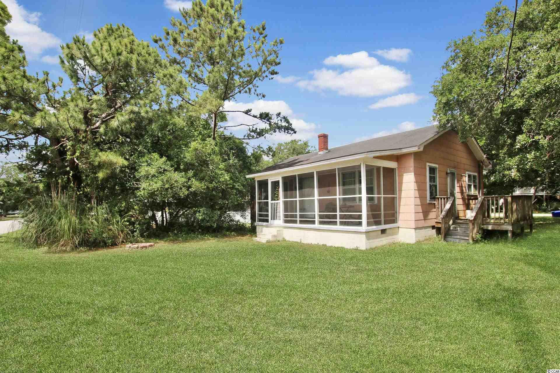 Introducing this enchanting 3 bedroom 1 bath home located just a leisurely stroll down to the white sandy beach. This charming home has an old school beach vibe with knotted pine walls & ceilings, an abundance of natural lighting, an inviting living room, and showcases a welcoming screened-in front porch. The fully equipped kitchen is ready for that low-country cookin' to be shared with your family & friends. Retire to one of the three comfortable bedrooms for an evening of peaceful sleep. This home affords you easy access to the beach and golfing along with all of the other activities and happenings in Myrtle Beach and the new Surfside Beach Entertainment District including fun eateries, award winning off-Broadway shows, public fishing piers, Marsh Walk, and intriguing shopping adventures along the Grand Strand. Conveniently located to your everyday needs, including grocery stores, banks, post offices, medical centers, doctors' offices, and pharmacies. Check out our state of the art 3-D Virtual Tour.