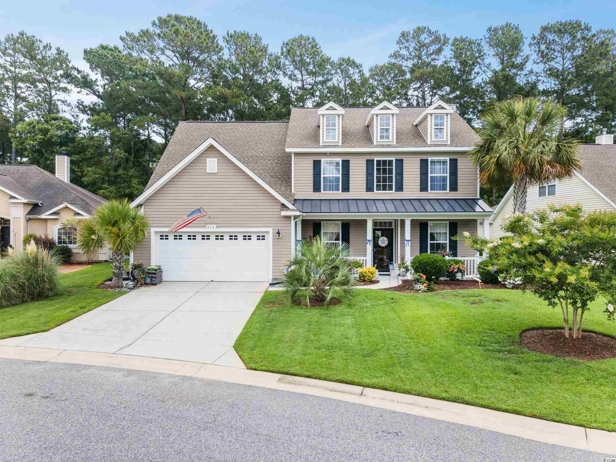 Don't miss this amazing opportunity to own a 5Bd/3.5 Bath home on the golf course at Arrowhead.  The curb appeal with lush landscaping and inviting front porch is just the beginning.  As you enter into the 2 story foyer you are greeted with high ceilings, lots of windows and natural light highlighting the beautiful wood floors. A den/formal living room and a formal dining room with plenty of space for a butlers pantry lead to the expansive 2 story living room.  Entertaining will be a joy with your large kitchen complete with a work island, breakfast bar, silestone counter tops, 42 inch cabinets and a breakfast nook.  The first floor Master Suite offers lots off privacy and gorgeous golf course views of the 7th hole of the Lakes course.  A large walk in closet and ensuite bath w/ a 5 foot walk in shower and dual sinks provide a spa like experience.  Upstairs you will discover a second Master Suite with a full bath and 3 additional bedrooms along with another full bath.  Can you find the door leading to a third floor walk up attic?  This ample secret hide away (27' by 15') can be converted to a 6th bedroom or additional living space.  Plenty of closets and an attached oversized 2 car garage allow for plenty of storage.  Fresh paint throughout and all new carpet on the second story along with new custom shades are waiting for you.  Call today!