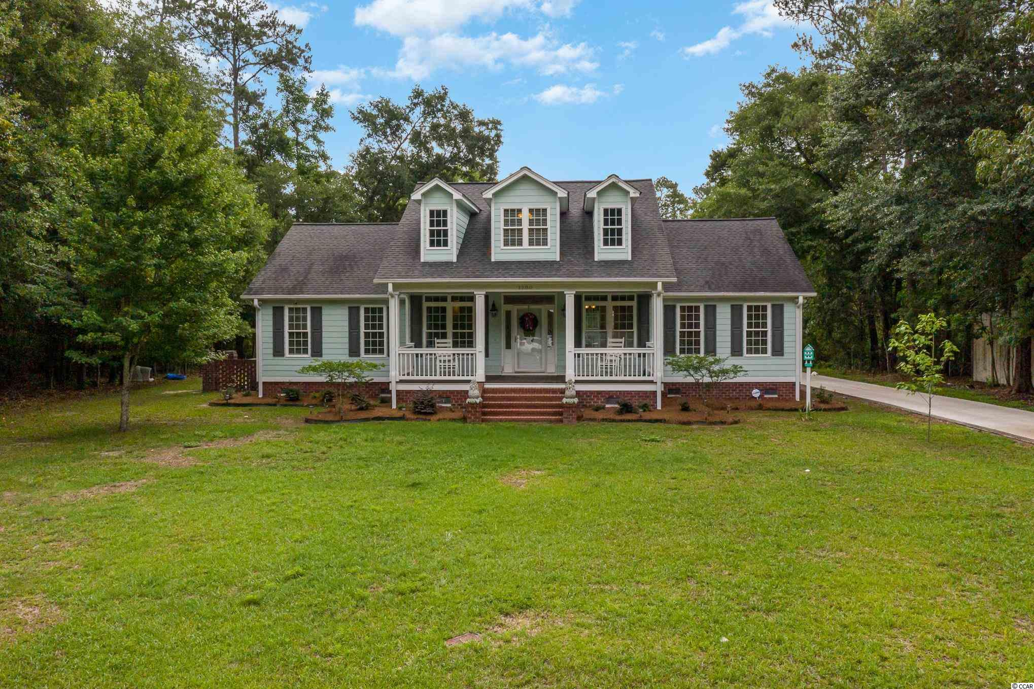 Ranch-style River home with 3 spacious bedrooms and 2 full bathrooms on a direct River Front lot. This beautiful custom built home sits on 0.55 Acres of land that backs up to the Waccamaw River. Has never flooded due to higher elevation of land. This home offers tons of privacy for folks who want a true country living in a quiet neighborhood. Approx. 15 minutes from Downtown Conway & 20 minutes from Myrtle Beach. 1.5 miles away from Shaftesbury Golf Course & no HOA.