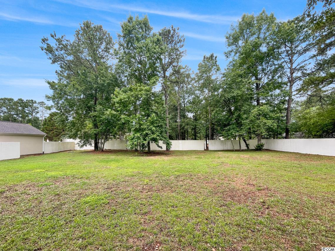Double lot, cleared, in beautiful Tidewater Plantation. Amenities include outdoor pool, clubhouse, tennis court, private beach cabana, fitness center, and more! Award winning golf course community, pool construction allowed, and wooded area behind lot will not be developed. Don't miss out on this amazing opportunity, come see it today!