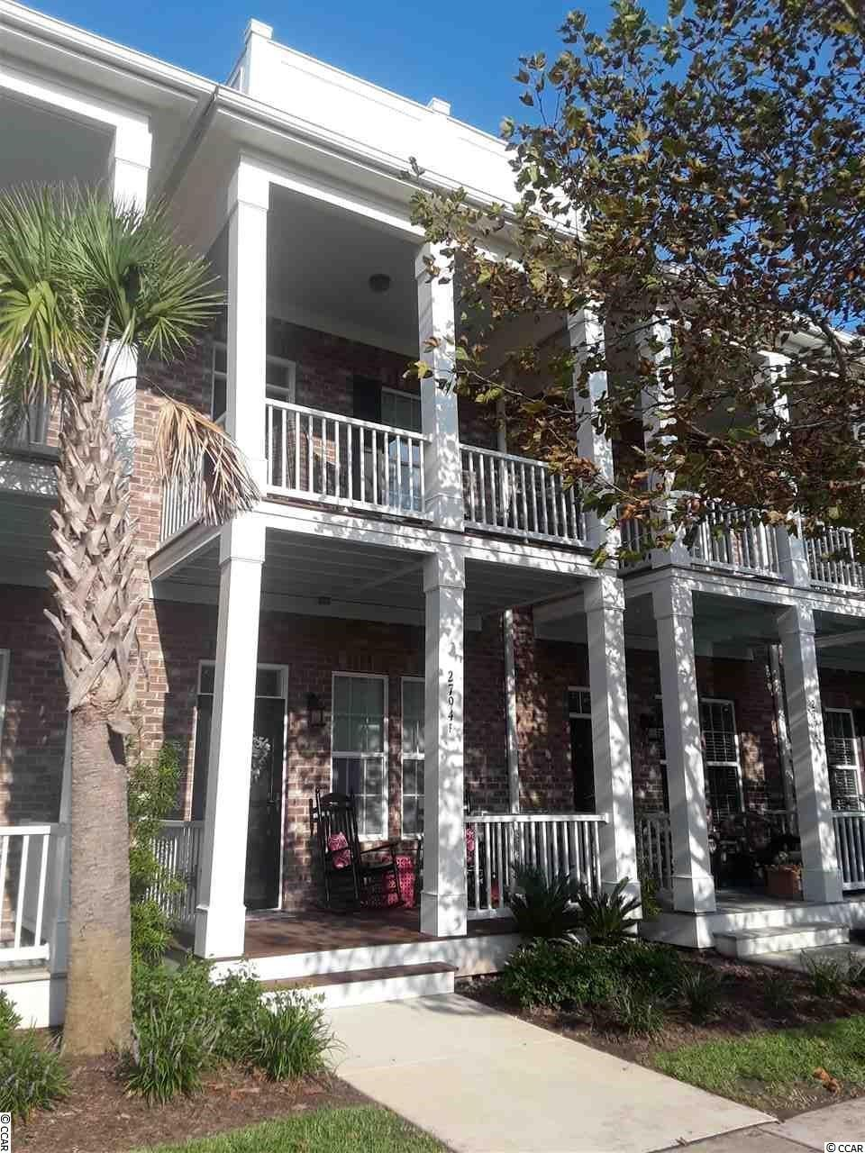 Here is the chance to own a beautiful townhome in the heart of the highly popular Market Common area of Myrtle Beach; which is a short walk, bike or golf cart ride to the great shopping, dining, parks and nightlife that highlights the neighborhood. This 2 bedroom, 2.5 bathtownhome with an attached garage is in a great location and barely a mile to the beach and 5 minute ride to the state park. This meticulously maintained unit has a plethora of upgrades not typically found in most townhomes; including hardwood flooring throughout the entire first floor. Both the master and the second bedroom feature an en suite bath with the master bath having a dual vanity and garden tub to go along with the separate shower and a nice size walk-in closet. This home is only 4 years old and has a sizable front porch to allow you to relax and enjoy the fabulous weather! And the large balcony off the master bedroom upstairs gives you a great view of the neighborhood. The pool, along with the lazy river, hot tubs and amenity center is less than a half mile away. Don't miss the chance to own your own personal oasis or great investment property in the best neighborhood in The Market Common! Exterior insurance, amenity center and landscaping are included in the low HOA fee. Call today to schedule your personal showing; you will beglad you did!  There is a tenant in place with a lease through the end of October, but they may be willing to terminate the lease early if desired.  For investors, they would also like to extend their lease to go month to month once it expires.