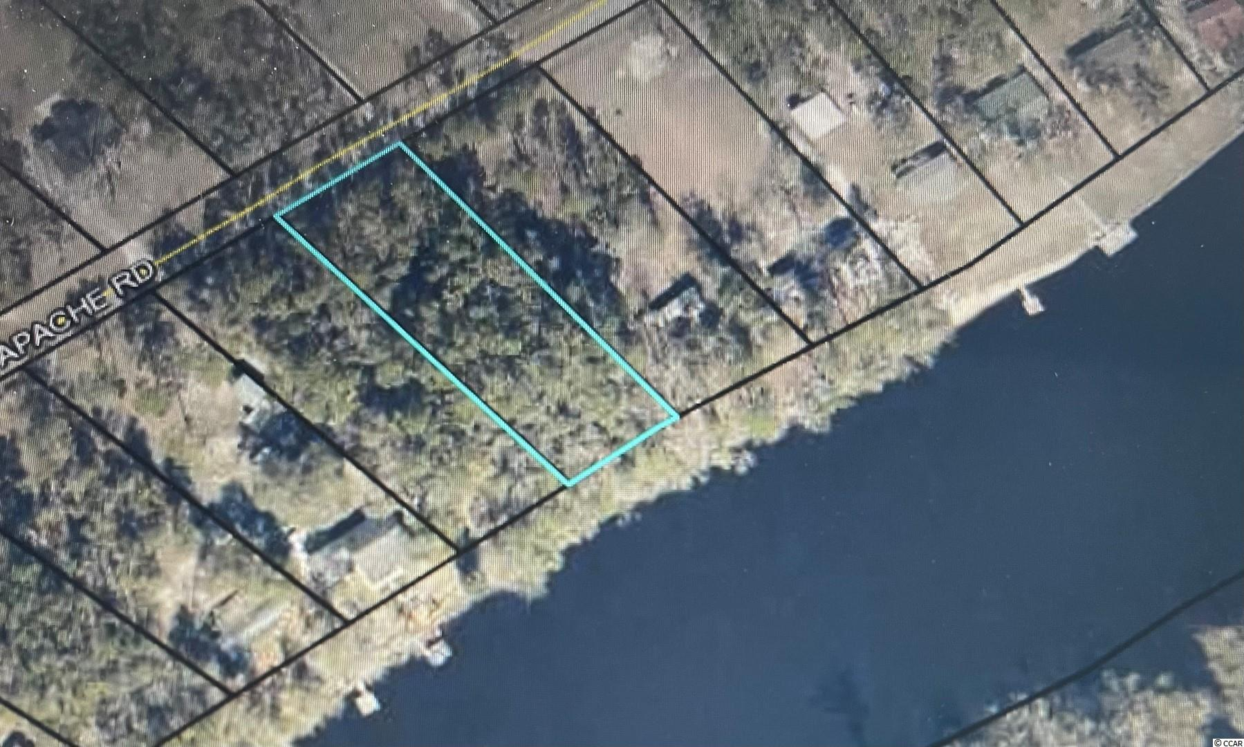 Beautiful river lot with 100 feet of river frontage just waiting for someone's dream home. Established neighborhood with it's on private boat ramp. Still close enough to Georgetown for full time living or use for a weekend getaway. Measurements are approximate and not guaranteed. Buyer responsible for verification.