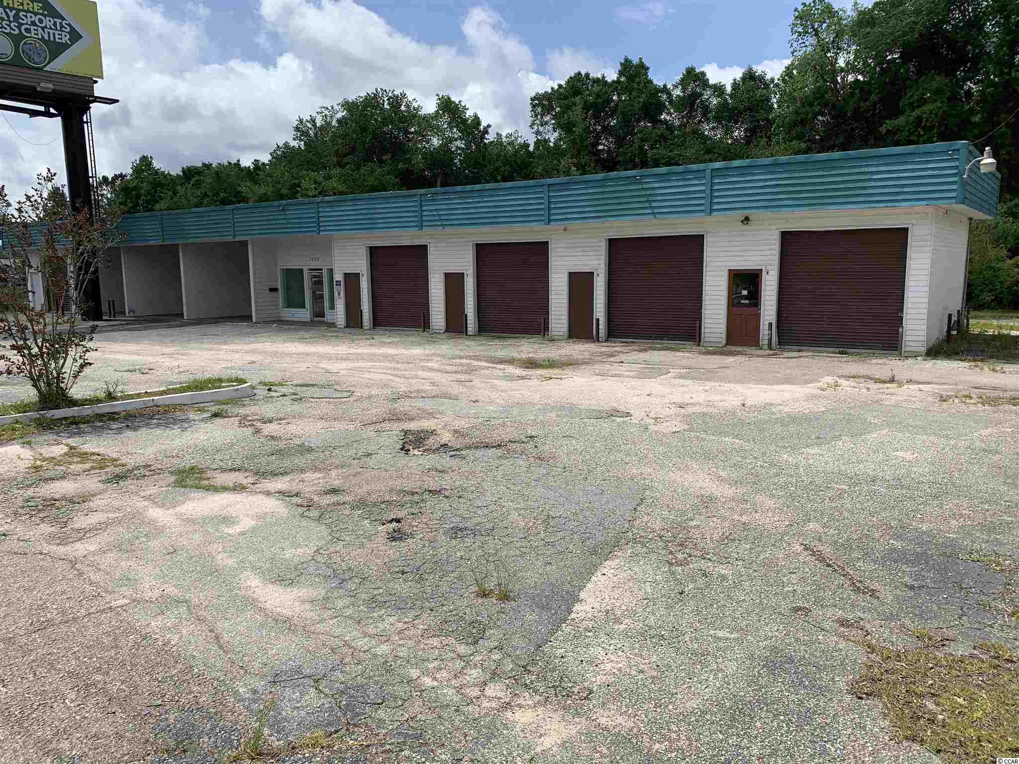Carwash and Storage units located on Highway 501.  Property has 3 open bays and 5 bays with sliding doors on both sides for easy access.  Bays are 24' deep x 15.5' wide x 15' high.  Property has 107' of frontage along highway 501.  Large amount of parking space in rear of the building along with 10 car parking in the front.  All measurements are approximate and not guaranteed, buyer is responsible for verification.