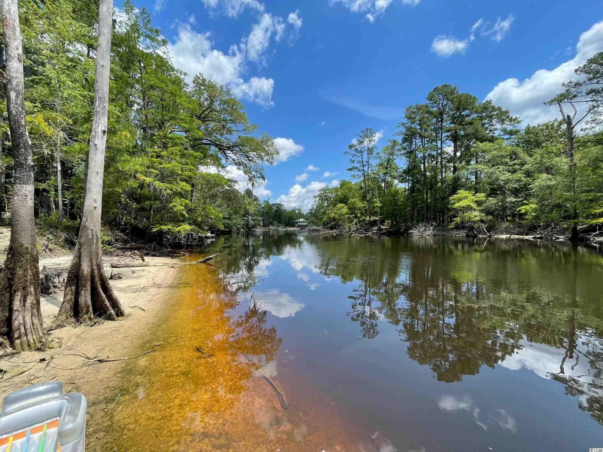 Beautiful acre home-site located on the Waccamaw River. This is a great location to build your river front dream home. This lot offers nearly 180+/- ft of river frontage, with utilities already in place for home. Not only does this lot already have utilities in place, but it also includes home plans, engineering, and elevation certificate. Located close to down-town Conway, and the Marina. Call today for more information!   * This lot does flood, home would need to be built on stilts.*