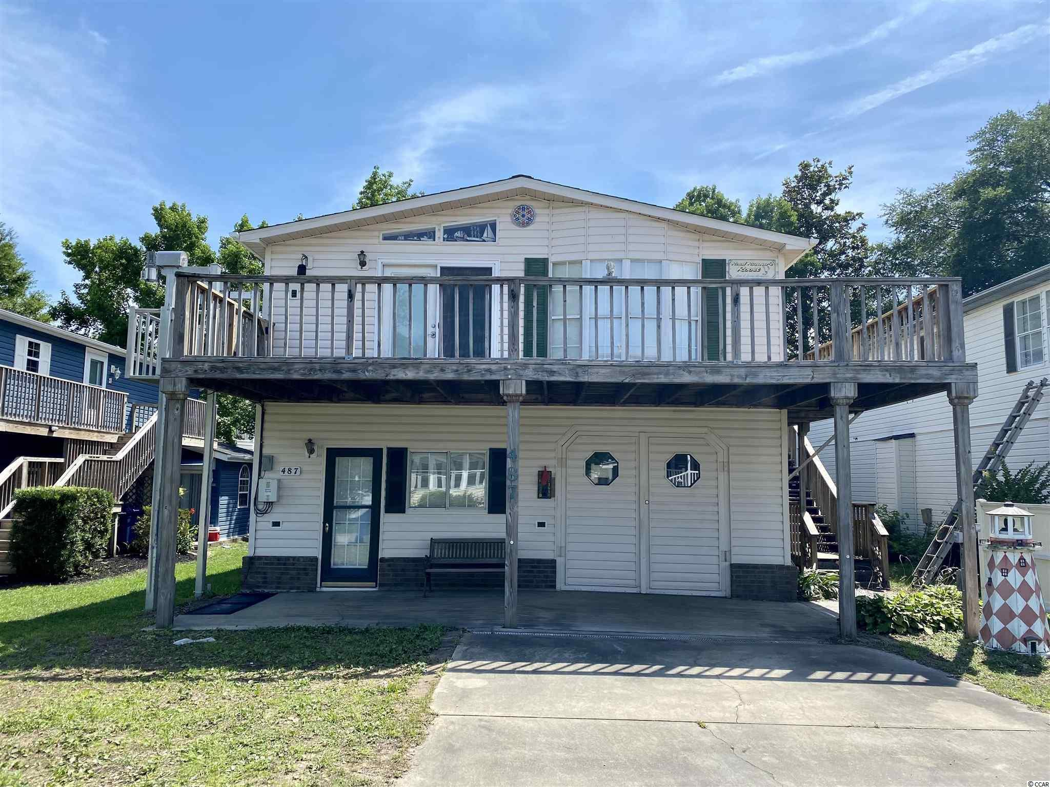 Don't miss out on this opportunity! This home is located in the gated resort community of Oceanside Village. Featuring an open concept with 3 beds & 2 baths.   Home features an outdoor elevator.  Private Beach Front Parking