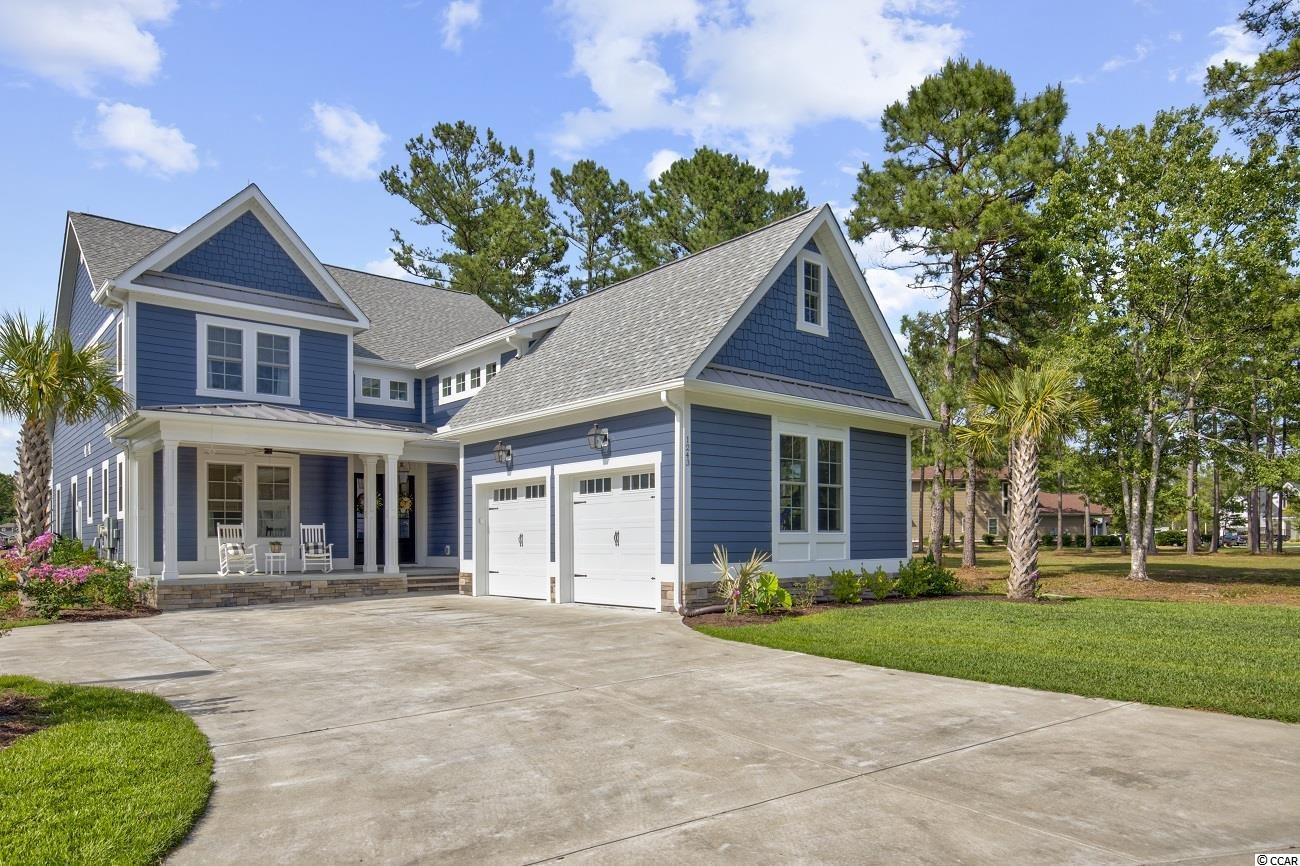 Wanting a new home WITHOUT the build time!? This two year old home is a true showstopper! From the moment you walk into the breathtaking foyer, the barrel ceilings, attention to detail and craftsmanships will immediately catch your eye. This 5 bedroom, 3.5 bath home can be found in the highly sought after neighborhood of Waterbridge in the Carolina Forest Section of Myrtle Beach. In addition to the 5 bedrooms there is also an office, a loft upstairs, carolina room, 2.5 car garage and 395 sq ft of unfinished space on the second floor that can be converted to a larger office, additional flex room or mother in law suite. They don't call the kitchen the heart of the home for no reason, in this home you will find a custom navy blue island with Quartz countertops and backsplash, custom cabinetry with soft close doors, stainless steel appliances, a double gas oven, gorgeous light fixtures and top of the line hardware. This home also offers a mother in law suite, extra bedroom and a laundry room on the main level; as well as an open concept area to entertain guests both inside and outside of the home. The all seasons room can be used year around, and you will enjoy cooking out with friends on the outdoor kitchen complete with a top of the line gas grill that is directly connected, so no propane tank necessary. This home features an irrigation system, coffered ceilings, high end stainless steel appliances, whole house water softener system, custom window treatments throughout just to name a few. Please ask for the feature list sheet to see everything this grande home has to offer. The premier gated community of Waterbridge features South Carolinas #1 neighborhood pool with a swim up refreshment bar, cascading water falls and a heated whirlpool. There is also tennis courts, a sand volleyball area, an upscale community center,  fitness center, boat and rv storage and a unique 66 acre recreational lake throughout the community for boating and fishing. If you are looking for a l