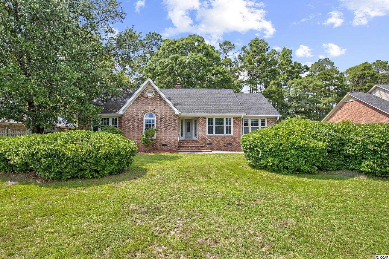 This beautiful, well landscaped, three-bedroom, two-bath home is in the desired Coastal Heights neighborhood.  The house also has a bonus room that can be used as an office, a dining room, or an additional bedroom if desired. Enjoy the peaceful backyard, which backs to trees and the eighth hole of Coastal Carolina University's golf course (there is a path through the trees leading to the tee box for the ninth hole).  The house has an oversized two-car side load garage with ample room for additional parking in its large driveway.  The roof was replaced in 2016, the crawl space was encapsulated in 2017, and there is an in-ground irrigation system to keep everything green.  This house is a short commute to Coastal Carolina University and is close to the Conway Medical Center.