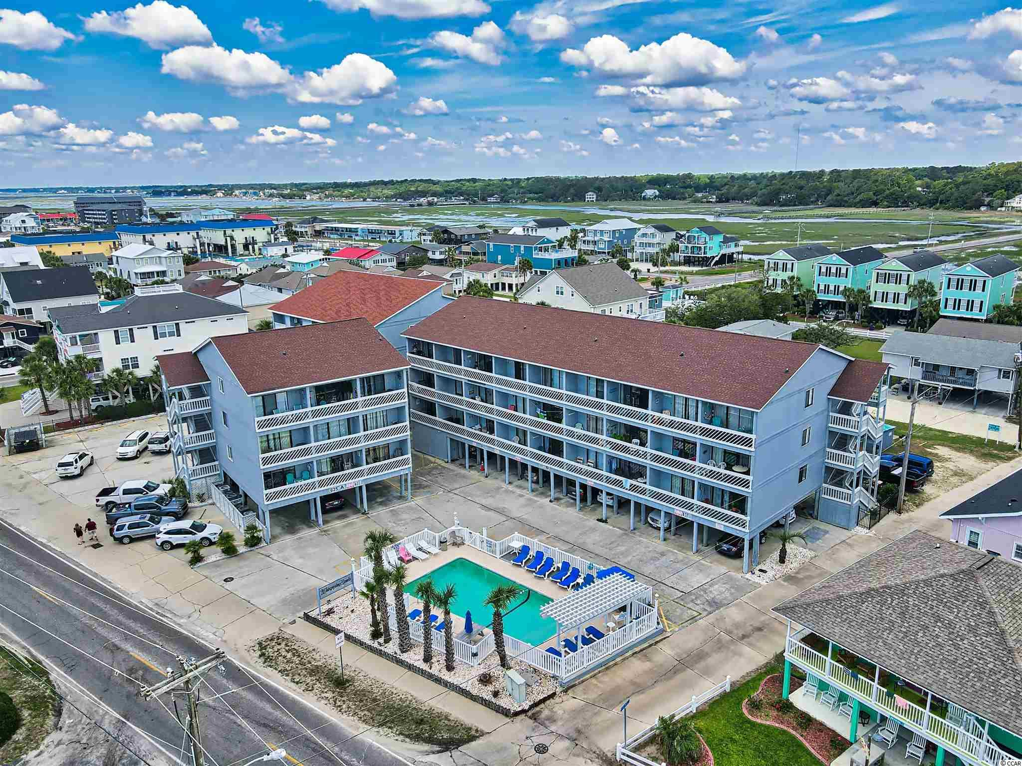 Great price on this bright cheery beachy 1BR BA bungalow just steps to the beach. A short walk to Garden City Pier. Top floor, end unit. Balcony overlooking pool. Come check it out. It won't last long !