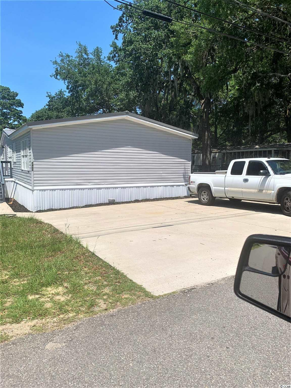 This home is the perfect vacation home or full time home in The Grove in Cherry Grove North Myrtle Beach. 4 bedrooms, 2 full baths, Large kitchen, Den and living room. Nice freshly stained deck for enjoying the summer breezes. NO HOA and a short golf cart ride to the beautiful Cherry Grove Beach, shopping, entertainment, restaurants and more. Come take a look before it gets gone.