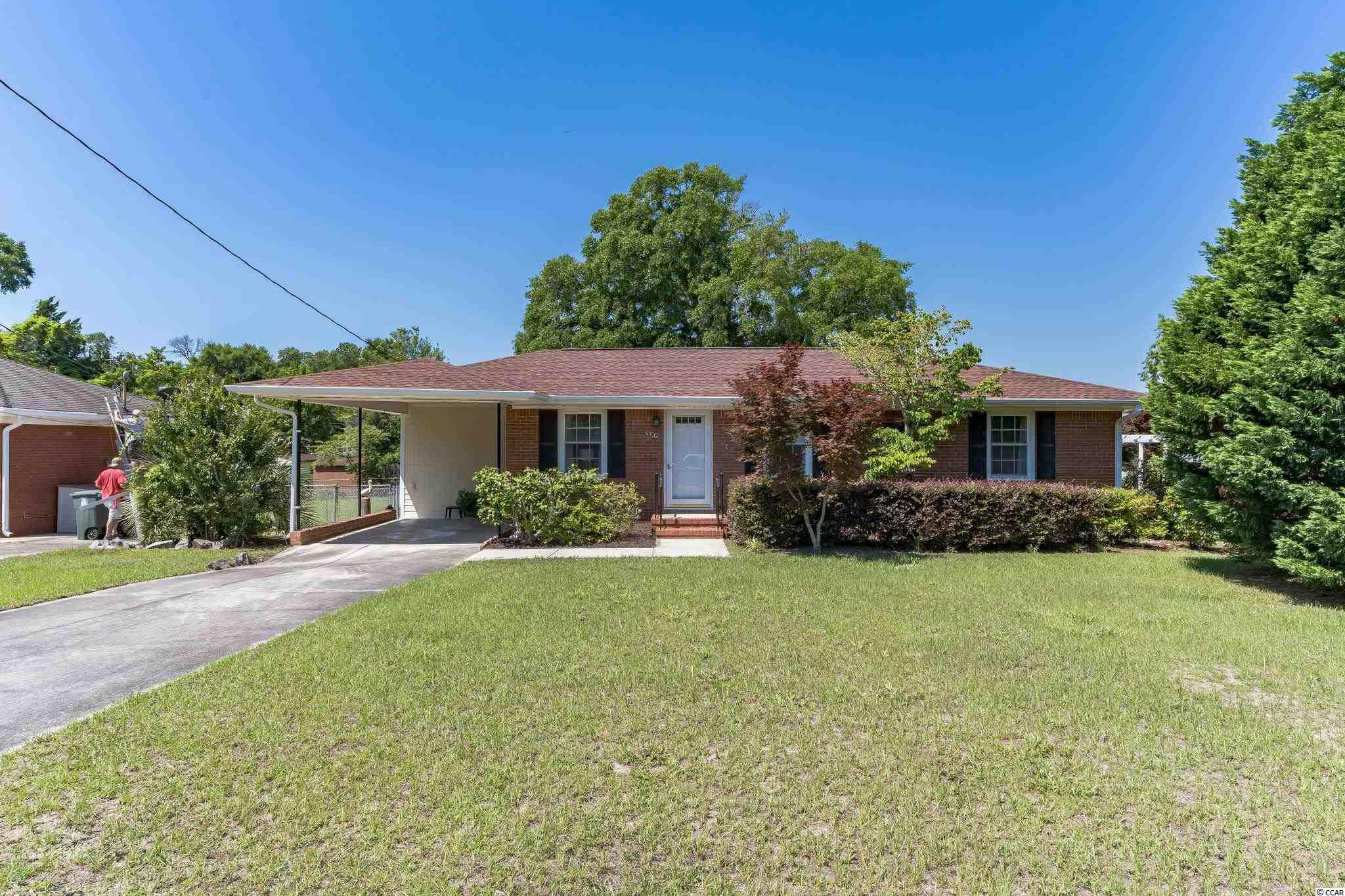 Immaculate Brick Ranch Home - Awesome location! only 2 blocks to McLean Park, 5 blocks to the beautiful Atlantic Ocean - just tucked away in a well established community -Plus No HOA's! This 3BR-2BA Brick home has been meticulously updated - New Roof - New Deck -Freshly Painted throughout - New kitchen & laundry room floors - newer windows throughout the home & a brand new slider door leading out to the new deck -  All new ceiling fans & outdoor light fixtures - refurbished original hard wood floors in Livingroom - working gas fire place plus new white bead board ceiling installed in the  family room - as well as an updated Master bathroom & Laundry room, with a new washer & dryer conveying. The owners have done all the heavy lifting for you! This charming Home is located on an oversized lot with plenty of beautiful trees & mature landscaping - the lot is large enough for an in-ground pool with plenty of room left over. Just a short walk or golf cart ride to the Beach and the Main St. restaurants & attractions - Set your showing appointment today!!! This is a Great Home & will not last long!