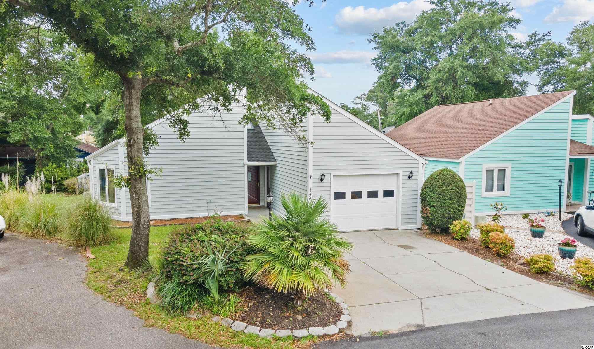 This freshly painted 3 bedroom, 2 bath home in the heart of North Myrtle Beach is located in the Ocean Drive section just a block off Main St. Recent updates include new flooring throughout, new lighting, new exterior paint and updated landscaping. The three spacious bedrooms and great storage make this a wonderful primary or second home. Located in Tilghman Woods you can easily take the golf cart to all NMB has to offer. Being East of 17 and just minutes from the beach, or shopping at  The Shoppes on Main, enjoying festivals and Music on Main are some of the pleasures this location will bring. The home offers a wonderful deck to enjoy lazy afternoons of entertaining and a private escape to just relax and enjoy all the good things living in NMB has to offer. Make plans to see this home today.