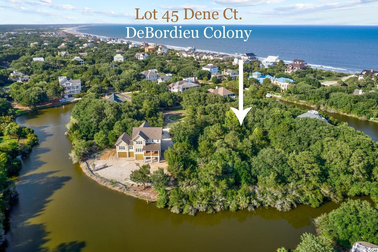 You'll enjoy sunrise over the ocean, and sunset over the marsh and creeks of North Inlet when you build your home on Lot 45 Dene Ct. in DeBordieu Colony, a remarkable, gated, residential paradise.  The higher you build on this .85 Acre lot, the more spectacular your views will be.  Add a roof top deck, as many have done, to allow for even more amazing views of the ocean, creeks, marsh and lakes.  Lot 45 is loaded with gorgeous live oaks and features 241 feet on the lake.  What's really great about this lot is that when the owners built the home to the east, they left a great ocean view corridor over their driveway!  Dimensions of this pie shaped lot, located at the end of the cul de sac, are 24 x 300 x 241 x 251.  Dene Ct is very close to the beach access and has a unique sense of privacy with only 10 homesites.  DeBordieu Colony is an oceanfront community located just south of Pawleys Island, South Carolina, about an hour north of Charleston, featuring private Pete Dye golf and tennis, saltwater creek access to the ocean, a 24/7 manned security gate, and luxury homes and villas surrounded by thousands of acres of wildlife and nature preserves. People who know DeBordieu Colony say there will never be another place quite like it. Come see for yourself!
