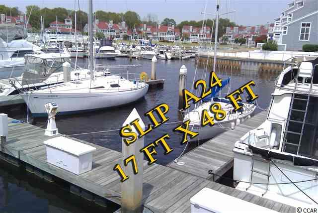 Rare 17'x48' Boat Slip, Own/Lease Minutes from ocean, clubhouse, pool & spa, tennis, more. Spectacular harbor with magnificent moss-draped live oaks and great views. Dockmaster on duty. Climate-controlled clubhouse w/nice lounge area & very clean bath/shower facilities. Easily accessible from Highway 17 N in charming hamlet of Little River. Lots of restaurants and shopping. Casino boat nearby.     * Spectacular harbor/dockmaster on duty     * Minutes from ocean. Approx. 3 miles to the Atlantic Ocean with easy access (no bridges).      * Climate-controlled clubhouse with nice lounge area & clean bath/shower facilities     * Pool & spa, tennis, more     * Pump out station, dockside water, electricity, cable, security, trash pick up & dock boxes     * Long-term rental allowed     * Easily accessible from Hwy 17 N & restaurants, shopping and casino boat nearby  All measurements are approximate and not guaranteed. Buyer responsible for verification.  Owner is licensed SC realtor.