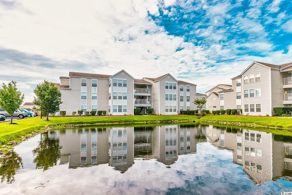 A true 2-bedroom, 2-bath condo situated on the heart of Surfside.  Serene pond views from Carolina Room and master bedroom of this tastefully decorated end unit with vaulted ceilings.   And you'll love the spacious closet in the master, the separate laundry room with ample storage, and the abundance of natural light from this end unit.  It's in close proximity to everything Myrtle Beach has to offer, and you're about 3 minutes to the beautiful blue Atlantic!