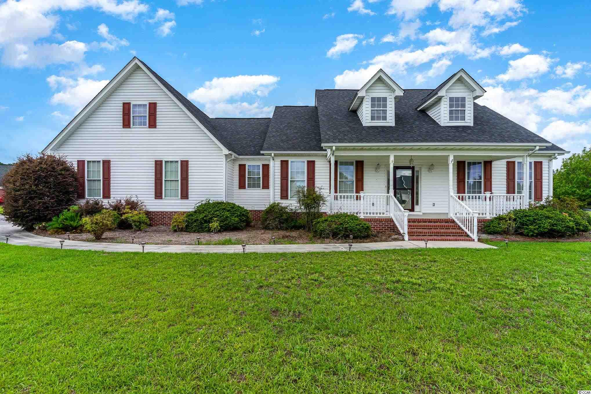 If a large yard, no HOA, and a truly spacious floor plan are what you are searching for, look no further! This home sits on just under an acre (0.99), has over 3100 heated square feet, and features a huge detached garage! This 4 bed/3.5 bath home provides a lot of value and space. The home has been used almost exclusively as a second home, and shows minimal wear and tear. Cook and entertain for a crowd with the large kitchen and formal dining room, relax by the fireplace in the oversized family room, or get some work done in the cozy office nook. On the occasionally cool nights, you can also enjoy a nice fireplace in the master bedroom  Outside, you can enjoy a nice breeze on the back deck while watching wildlife in and around the pond. If you have lots of tools or toys, there is plenty of room to store them in either the attached 2-car garage with storage rooms, or in the detached garage. The detached garage also has great potential for a man cave or she-shed! If quiet country living that is still convenient to all that Downtown Conway and the Grand Strand have to offer is for you, don't delay! Contact an agent today to schedule a showing.
