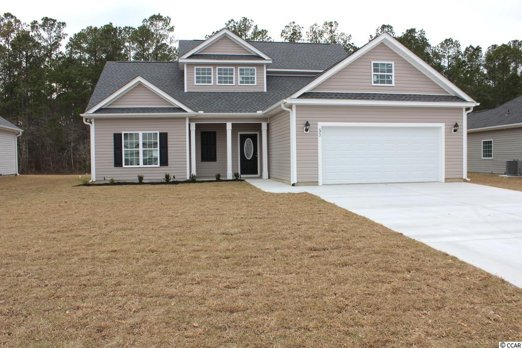 The Cypress, a 2-story plan incorporates a list of outstanding features in a competitively priced 4 bedroom, 2 1/2 bathroom new home. Beautiful 2-story foyer with an open staircase and windows to let light in. Large open living room, dining room and kitchen. The kitchen has black upgraded solid wood cabinets, stainless steel appliances - microwave, dishwasher, garbage disposal and smooth top stove, pantry closet and leads to a large concrete outdoor patio. First floor master bedroom has a tray ceiling, ceiling fan and bathroom that has a double bowl vanity, garden tub, walk-in shower, and large walk-in closet. Half bath and laundry room on the first floor. 3 large 2nd floor bedrooms and bath with double bowl vanity and linen closet. Bedroom 2 has a walk-in closet. Upgraded laminate flooring in the living room, dining area, breakfast nook, foyer, utility room and hall, carpet in all the bedrooms and waterproof vinyl in the bathrooms. Front porch and rear patio. Smooth ceilings, 30 year architectural roof shingles. Fully finished and painted garages with automatic door opener and pull down stairs to attic storage. Irrigation system, gutters, mailbox, sodded and landscaped yard. Community pool! Award winning local builder. Aynor Schools. Less than 1 mile to Hwy 22, within 30 minutes of Myrtle Beach. Photo's are for illustrative purposes only and may be of a similar home built elsewhere. Square footage is approximate and not guaranteed. Buyer is responsible for verification.