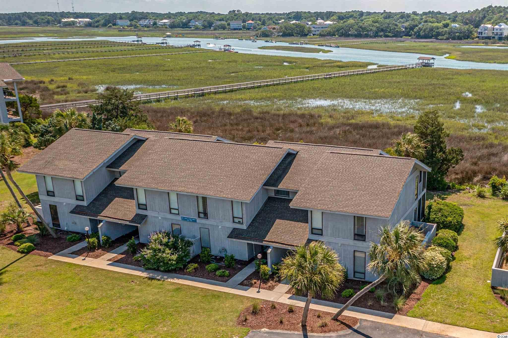 We have received multiple offers! Highest and best are due by 6/28/2021. Wow! If you have been dreaming about being in tropical paradise, this is the place for you! This lovely end-unit is located in the gated community of Inlet Point Villas at the tip of a private peninsula at Litchfield Beach in Pawleys Island! This unique ocean-front community has everything you could ever want! The white sandy beaches, beautiful turquoise water, and one-of-a-kind palm trees are waiting for you! This marsh-front villa has breathtaking views of the Inlet, and it's completely move-in-ready! Most of the unit has been remodeled, and it is being sold fully furnished, so it's completely turnkey! As you enter through the foyer, you will notice a large kitchen with a breakfast bar. This is a great open floor plan, which is perfect for entertaining! All of the appliances have been recently replaced with stainless steel. The dining room area features a tray ceiling along with plenty of space for everyone. There is a powder room downstairs for guests as well. The master bedroom is quite spacious, and it even has its own screened-in balcony where you can enjoy a good book. The master also has an en-suite bath. The laundry room is downstairs, and the washer and dryer will convey. They were both replaced recently. The other two bedrooms are very big, and one of them has a balcony where you can soak up the sunshine and gaze at the magnificent view of the Marsh! This remarkable villa has been well-maintained by the original owners. This unit has been in the family for generations. HVAC was replaced in 2014, and the hot water was installed this year. There is a huge screened-in porch right off the dining room where you can feel an amazing ocean breeze! This is a great place to eat lunch or sip on your favorite beverage. There's a patio for grilling and a storage room for all your beach necessities. So, come sit back, relax, and let the hoa maintain everything for you! Fees include: cable, interne