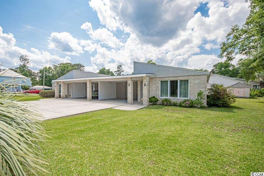 SHORT WALK TO THE BEACH! Welcome to the Town of Surfside, the Family Beach where walking to the beach, parks, shops & restaurants is what the locals do! This Mid Century Modern Duplex situated on a .34 acre double lot is located in the Ocean Terrace section of Surfside Beach. Completely renovated in 2018 with modern finishes and great natural light. The units are mirror images each other. Each unit includes 3 accommodating bedrooms, which open onto private courtyards, 2 full bathrooms & laundry/utility room, large exterior storage room with covered parking & additional driveway parking. Kitchens feature white cabinetry with floating display shelves for ample storage with modern aesthetic, stainless steel appliances & beautiful Brazilian granite counter tops. Master bedroom offers an ensuite bathroom with large walk-in closet. This unique duplex was designed with no shared walls for the interior spaces, allowing quiet enjoyment for the occupants of each unit. Rare opportunity with endless possibilities!