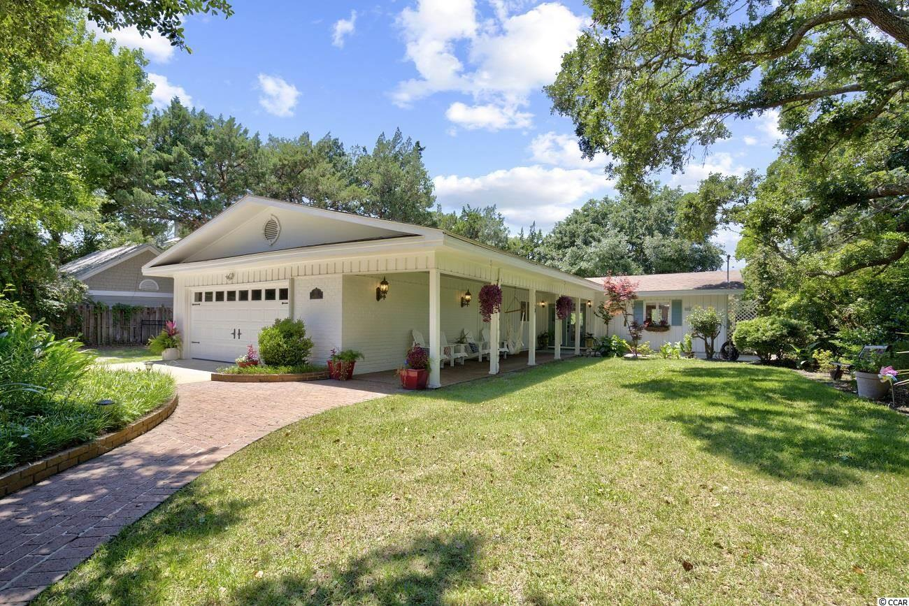 Welcome to Lakeshore Drive in North Litchfield. Dripping with character, this charming mid century/mod style home sits less than a thousand feet to the nearest beach access. Entertain friends in the fenced in backyard while taking in the views and privacy of Flagg Pond.  The pond occupies seven of the thirty protected acres bordering the rear of the property. Be one of the lucky few to enjoy the view! Only a handful of homes border Flagg pond. Upon entering you will notice the semi open floor plan and raised ceilings create a space that is bright with natural light. Truly makes for a soothing atmosphere worthy of a catalog feature article. Schedule your showing today!