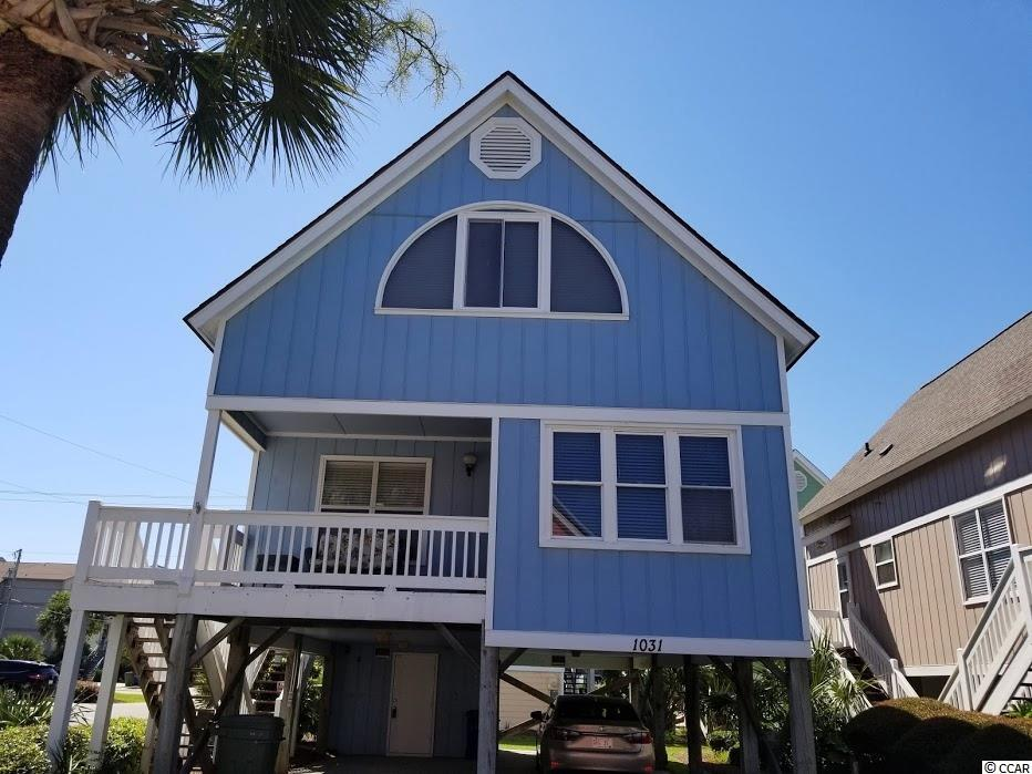 A standard in Surfside since the 80's, 33 single family, 1 and 1/2 story raised beach homes with a community pool, directly across the street from the ocean. This house is on the corner so it has especially easy access to the beach. It is furnished, never has been rented. Downstairs master bedroom has a walk in closet, 1/2 bath downstairs for guests, cypress planked walls makes for easy upkeep and attractive in a beach house. One bedroom upstairs is especially large and has an alcove area that could be sitting area or extra sleeping space. House does convey fully furnished and complete with 1 yr home warranty. Ready for immediate occupancy.
