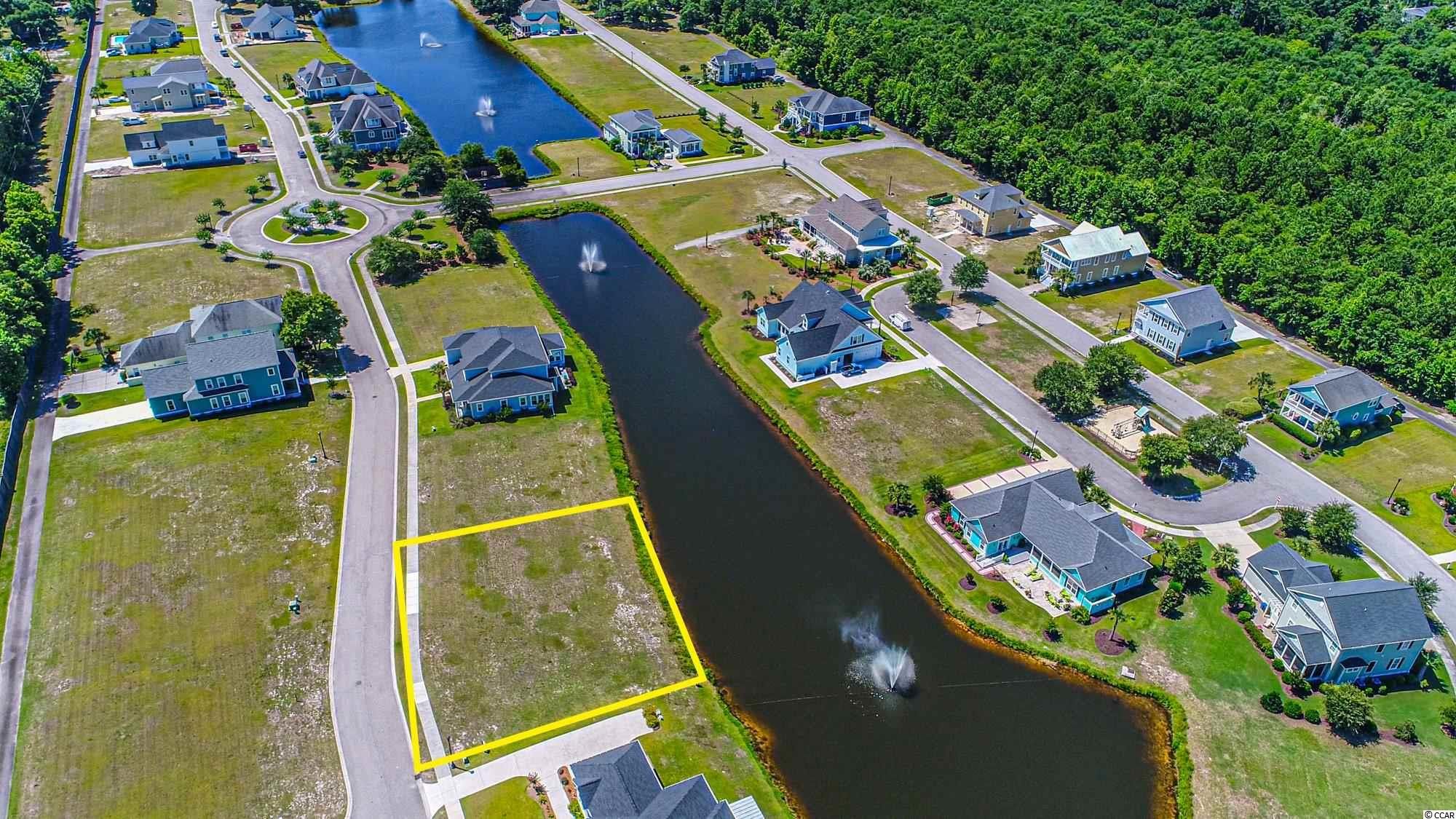 Can't miss opportunity to build your dream home in the gorgeous Charleston Landing.  This oversized lot is one of the few lots in Charleston Landing wide enough to accommodate a wider one-level home with a side entry garage.  129 feet on the road and 110 feet on the pond!  A must see in person to picture your home here.  Buy now, choose your own builder, and build when ready (no timeframe to build). Community amenities include: Marsh front Cabana, Swimming Pool, Gazebo, Pier, Walking Trails, Basketball Hoops, Playground, and much more.