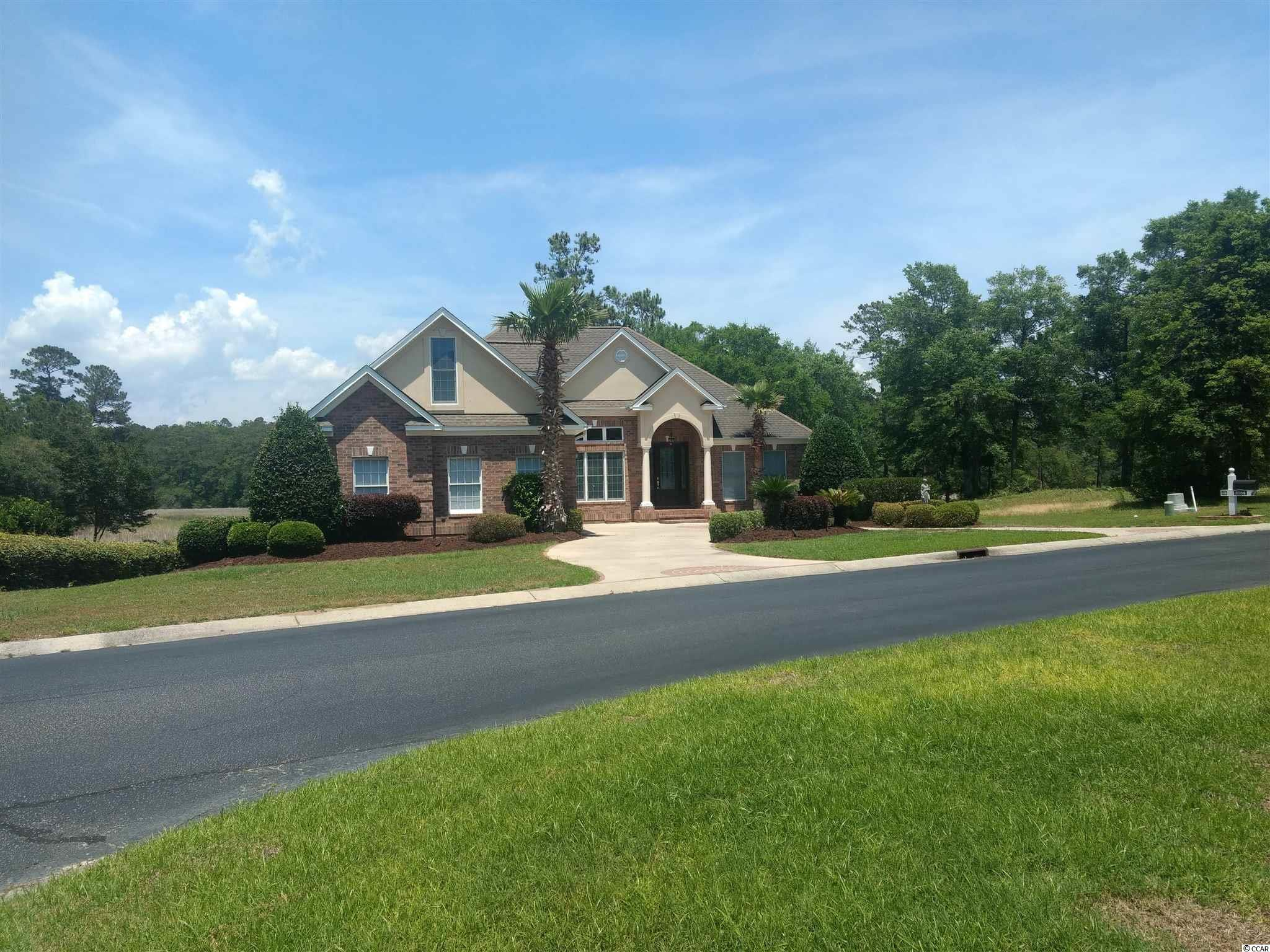 This marsh/creek front custom built executive home is in the gated community of Big Landing Plantation.  The community offers a clubhouse w/pool and ICW pier.  Owner is a licensed SC Realtor.  This custom built home contains many extras such as granite wet bar, low profile gas log fire place, Anderson windows/doors, undermounted Ipe deck on the marsh, tongue & groove oak floor , 12 ft ceiling, custom moldings in main living area, custom window treatments, on demand thankless Rinnai hot water heater, professionally designed pantry & master closet, stainless appliances such as Jenn-Air gas stove, GE Winecooler & beverage cooler, new GE dishwasher.  When a power outage occurs, the Briggs & Stratton Standby Generator will start immediately.  This generator is powered by the 500 gallon, in ground tank.