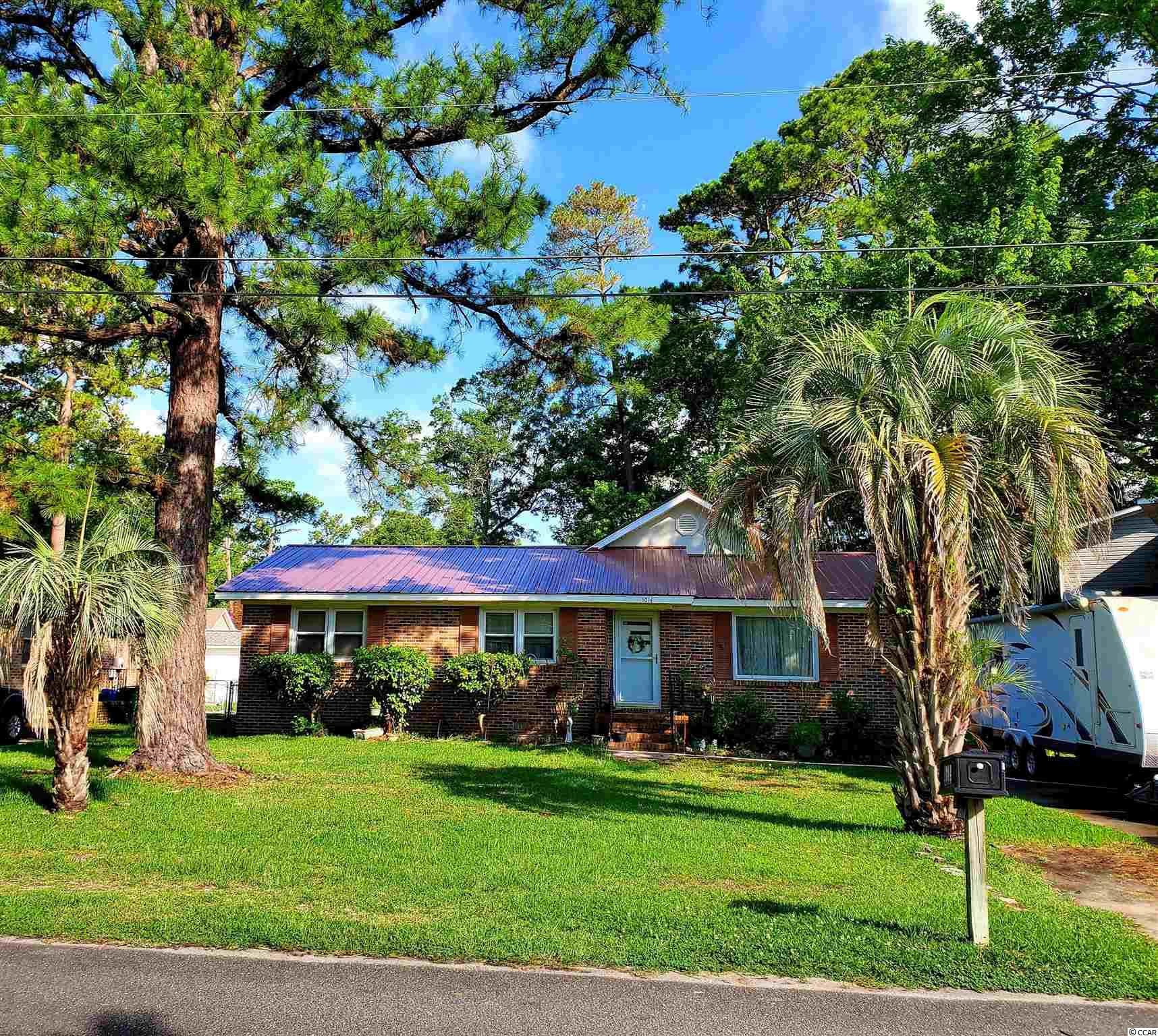 Don't pass up the chance to own this beautiful brick home east of 17 in the town limits of exclusive Surfside Beach.  Home has been updated with top notch features. Large living room and kitchen. Great size front and back yards. Back is large enough for pool with ease. Two primary suites at opposite sides of the house, two guest bedrooms, one is being used as an office and most can fit king size beds with furniture.   2.5 bathrooms and a formal dining room. Wrap around deck accessible by 2 sliding doors. No Flood insurance necessary. About 7 blocks to the beach, and 3 blocks to the children's park all accessible by walking or golf cart. No HOA so bring your toys, campers, motorcycles or boats are allowed. New roof 2021, new hot water heater 2021. HVAC 3 ton unit 2017. Kitchen has granite counter tops, Maple Cabinets and stainless steel appliances installed 2019. Kitchen undated,with an addition of formal dining Room, large back deck, Primary bedroom and bath in 2005.  All measurements and data are deemed reliable but are not guaranteed, buyer and or buyer's agent to verify.