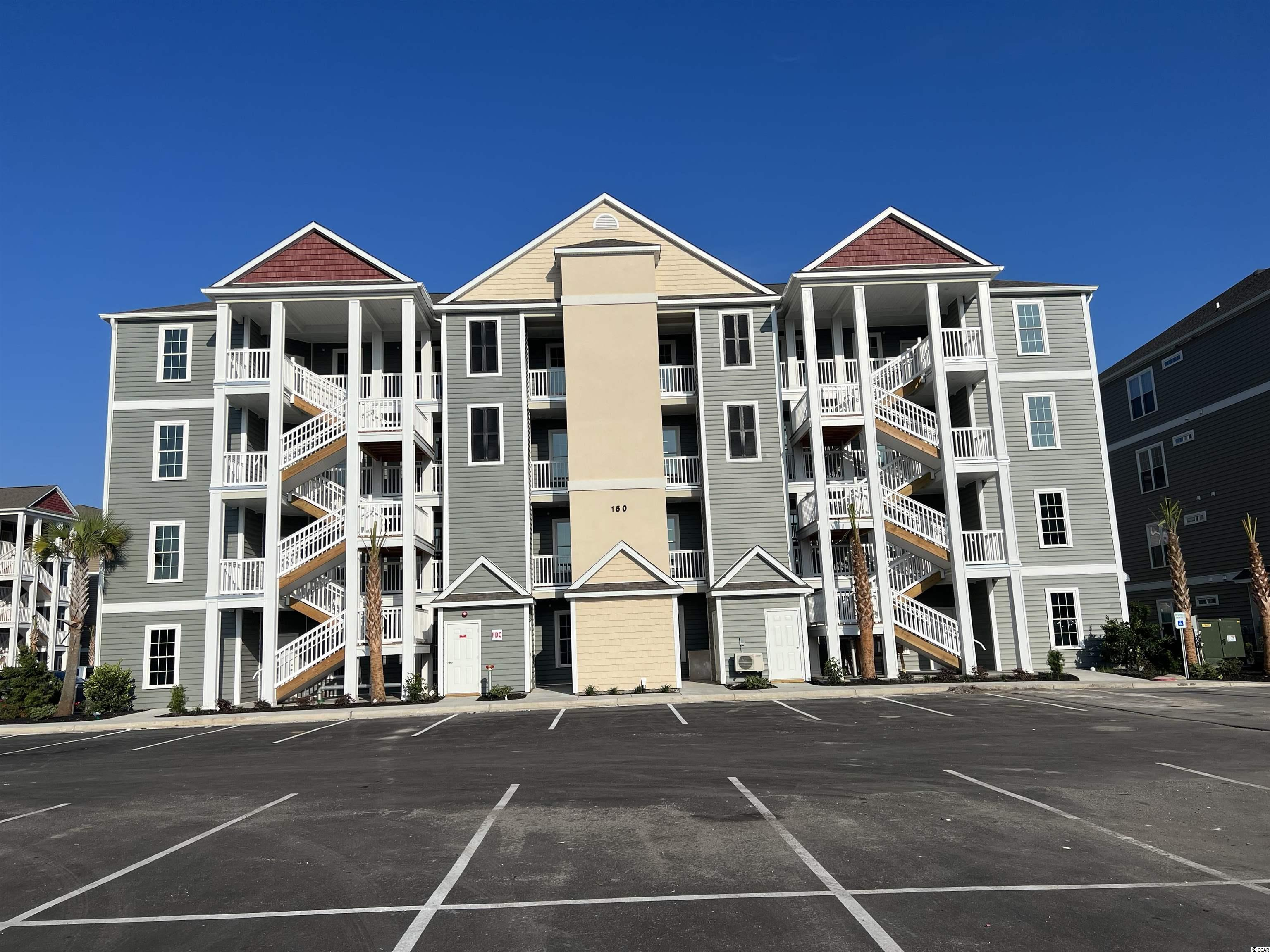 Located in one of the most successful condo developments in the Myrtle Beach area, this second floor interior unit is a 2 bedroom 2 bathroom beautiful condo in the very popular Queens Harbor! Building has an over-sized ELEVATOR to all floors, outside storage, split bedroom floor plans with entry to the Master Suite from the Family Room, 9' smooth ceilings and a screen porch. The location is superb with shopping, dining and recreation steps away. The amenity package includes a resort style swimming pool with club house and conveniently located picnic areas with grills.
