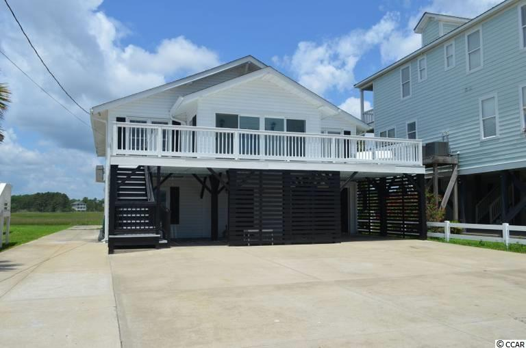 Welcome to Garden City Beach & Marsh Quarters. The name is perfect because of the beautiful marsh creek views. Watch the sun rises in the front of the house & the sunsets on the back patio, upper deck or the fishing & crabbing dock. This home has been recently renovated with room for your entire family & friends. Can sleep up to 16 people. Handicap access with an elevator, for those you love that can enjoy the beach with you & not have to deal with stairs. Walking distance to the beach, restaurants, the Garden City Pier and many other fun places to visit. Rent a golf cart for the week if needed. Great rental potential & your little piece of paradise for when you need a little down time. What are you waiting for. Your family deserves this home. Call today for private Saturday only showings or questions about this or other homes in the area. Remember, when buying or selling a home, Relax... We'll take it from here®
