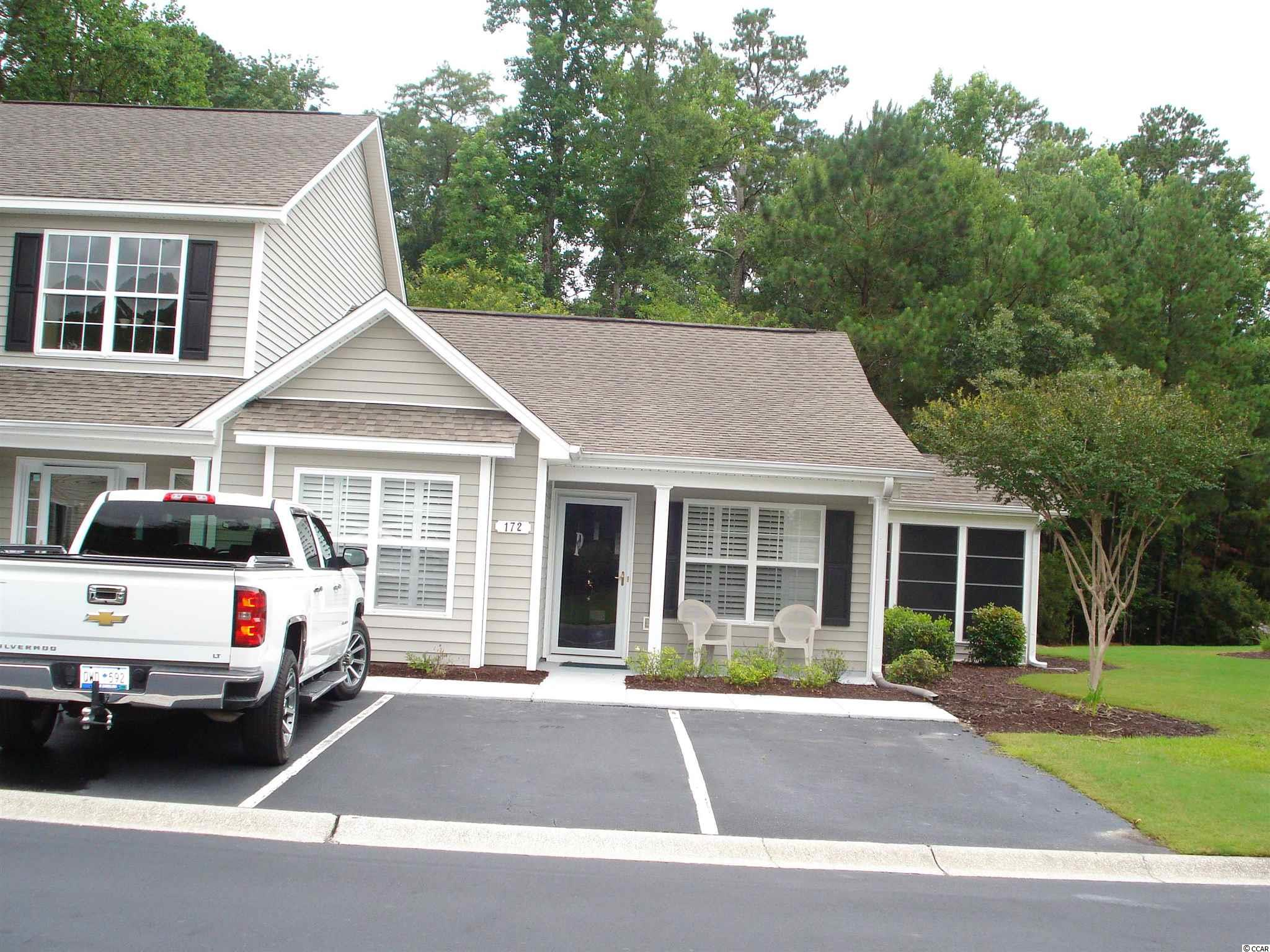 This True Townhome is looking for a new owner and has been well loved and taken care of. Located at The Glen's of the International in Murrells Inlet. This townhome is a one level end unit with plenty of outdoor living. A paved walk way to your front porch, an easy breeze porch off of your dining room, a rear screened porch and patio off of the kitchen to enjoy the large private backyard. Two generous sized bedrooms, with the master having a private bath with large walk in shower.  A lovely open floor plan with vaulted ceiling in the living area, laundry room, dining area, attached storage area, plantation shutters throughout home, wood flooring, a bright kitchen with 42 inch cabinets, pantry, and all appliances. Your Realtor can provide you with the extensive upgrade list for this awesome townhome. The International Club offers top notch ammenities to include a beautiful outdoor pool, ammenity center, playground, and much more. Murrells Inlet is known for the most delicious fresh seafood, dining, golf, our beautiful beaches, state park, Brookgreen Gardens, and great weather. Make an appointment today to see your new home. All information is deemed reliable, buyer is responsible for verification.