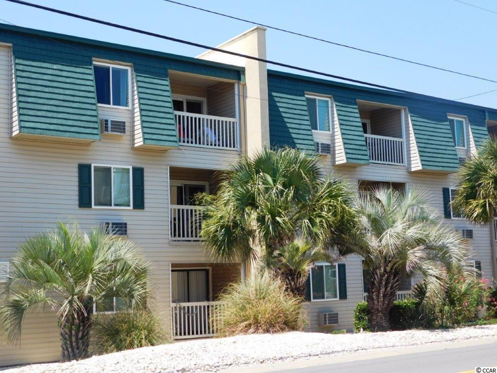"""Precious 2 BR/1.5 BA condo in desirable """"A Place At The Beach"""" in Cherry Grove.  Condo is a 3rd floor unit on second row affording you phenomenal ocean views from the kitchen, family room and front bedroom.  Walk into the unit and be greeted by an open airy floor plan boasting tile in all areas except carpeted bedrooms. Kitchen is open with eating bar, seating 4 bar stools, all appliances to include dishwasher, smooth top range, refrigerator and microwave.  Talk to your family and friends while working in the kitchen and OH yes, enjoy the ocean views.  Family room is larger and accommodates 2 large sofas, a full bath in hall with tiled floors and shower/tub to serve guests.  For you convenience one bedroom has a half bath as well.  Off the family room is a large deck affording awesome area for enjoying your morning coffee and afternoon cool drinks, while enjoying ocean views and ocean breezes.  Unit is being sold furnished.  When you're not walking across the street to the ocean, enjoy your community's beautiful pool.  See it, you'll want to own this one."""