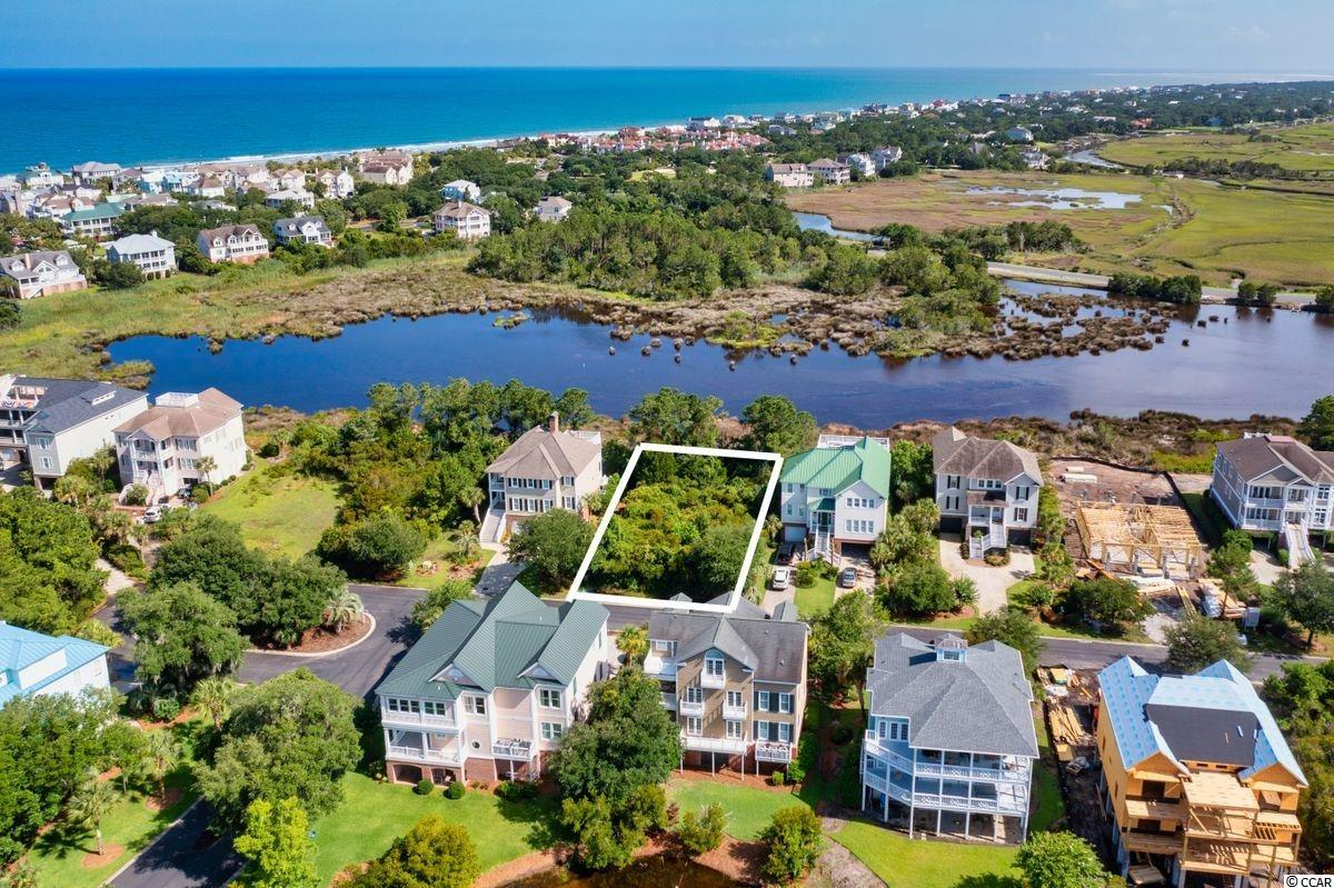 DeBordieu: This lot is located on the marsh in Ocean Oaks with incredible water views. Easy dedicated access to the beach either by a short walk or golf cart ride. If you are looking for the perfect place to build your new home, this is it!