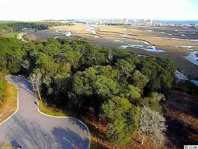 Beautiful marsh lot in Tidewater on the Bluffs. This lot has beautiful views of the Cherry Grove marsh. Tidewater has a community pool, tennis courts and beach cabana.
