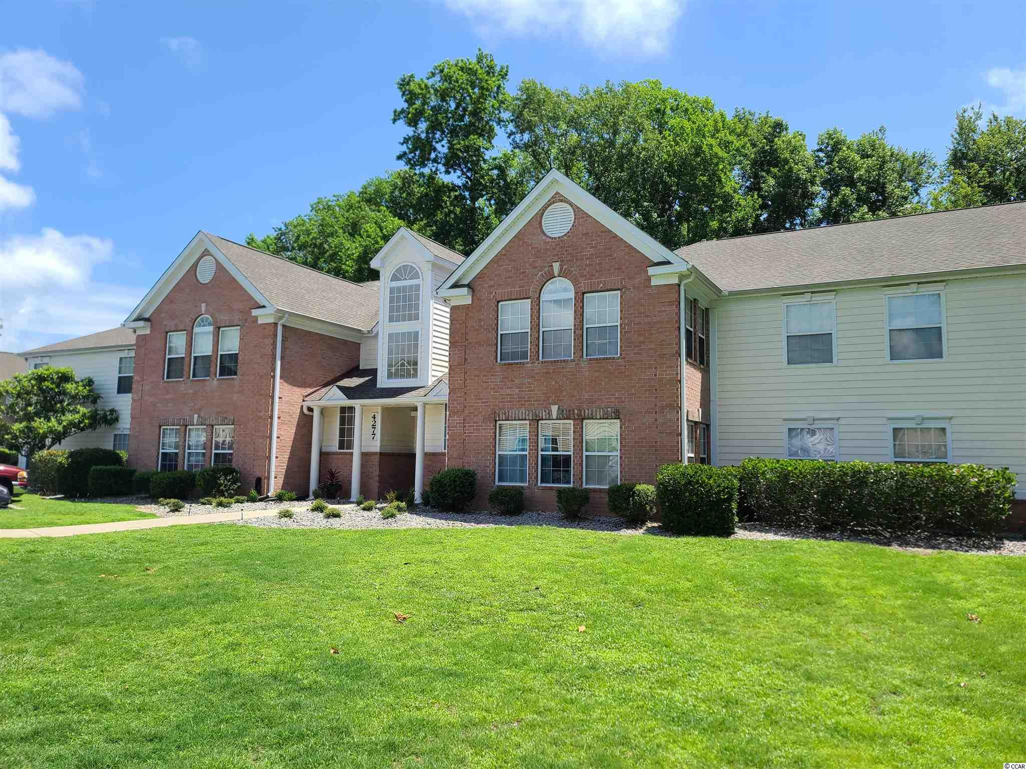 Spacious 3 BR/2BA condo with open floor plan and brand new paint.  Large Family Room is open to the huge Carolina Room and adjacent to the Kitchen, which boasts plenty of cabinet space and a breakfast bar.  Master Bedroom features a large vanity, along with a separate tub and shower.